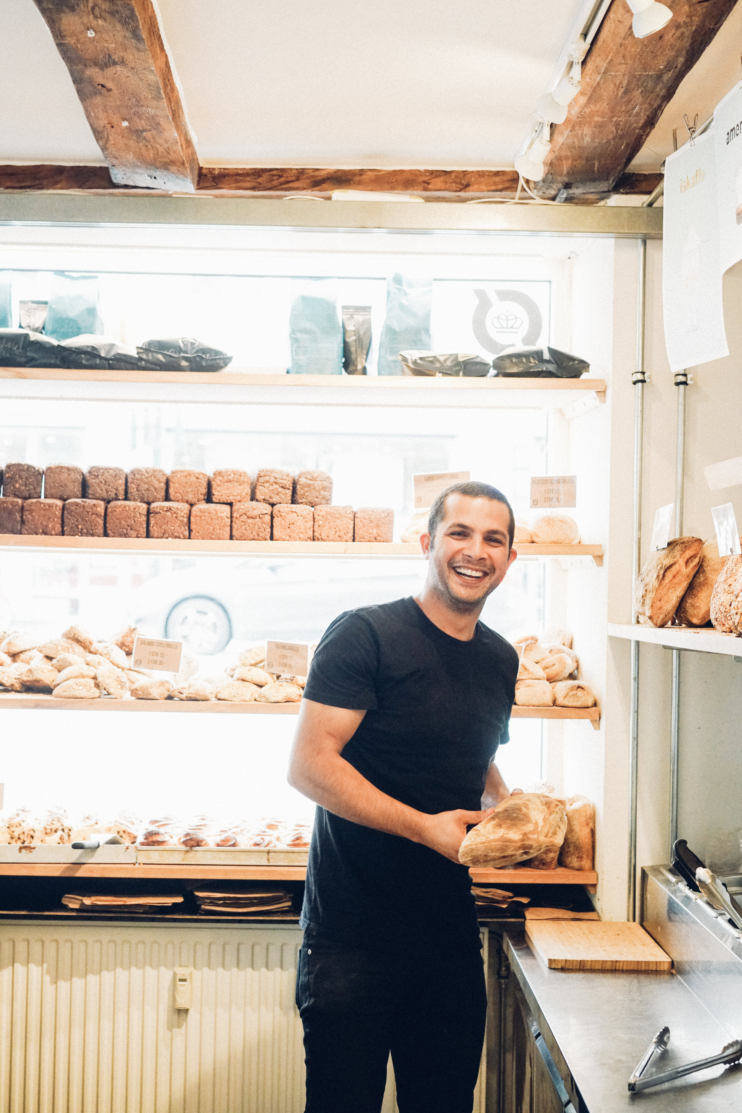 Martin Daniali holding a loaf of bread