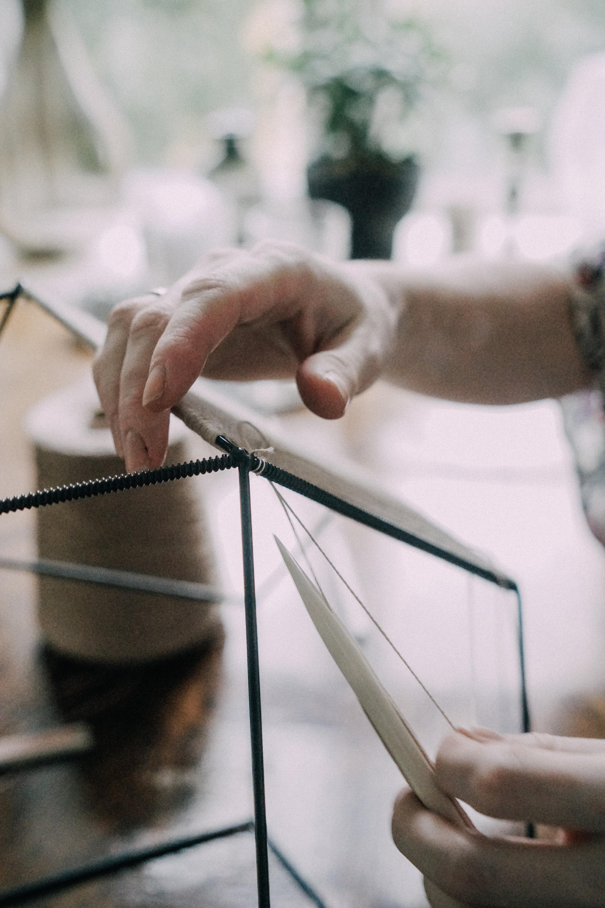 Alexandra Raben cutting threads