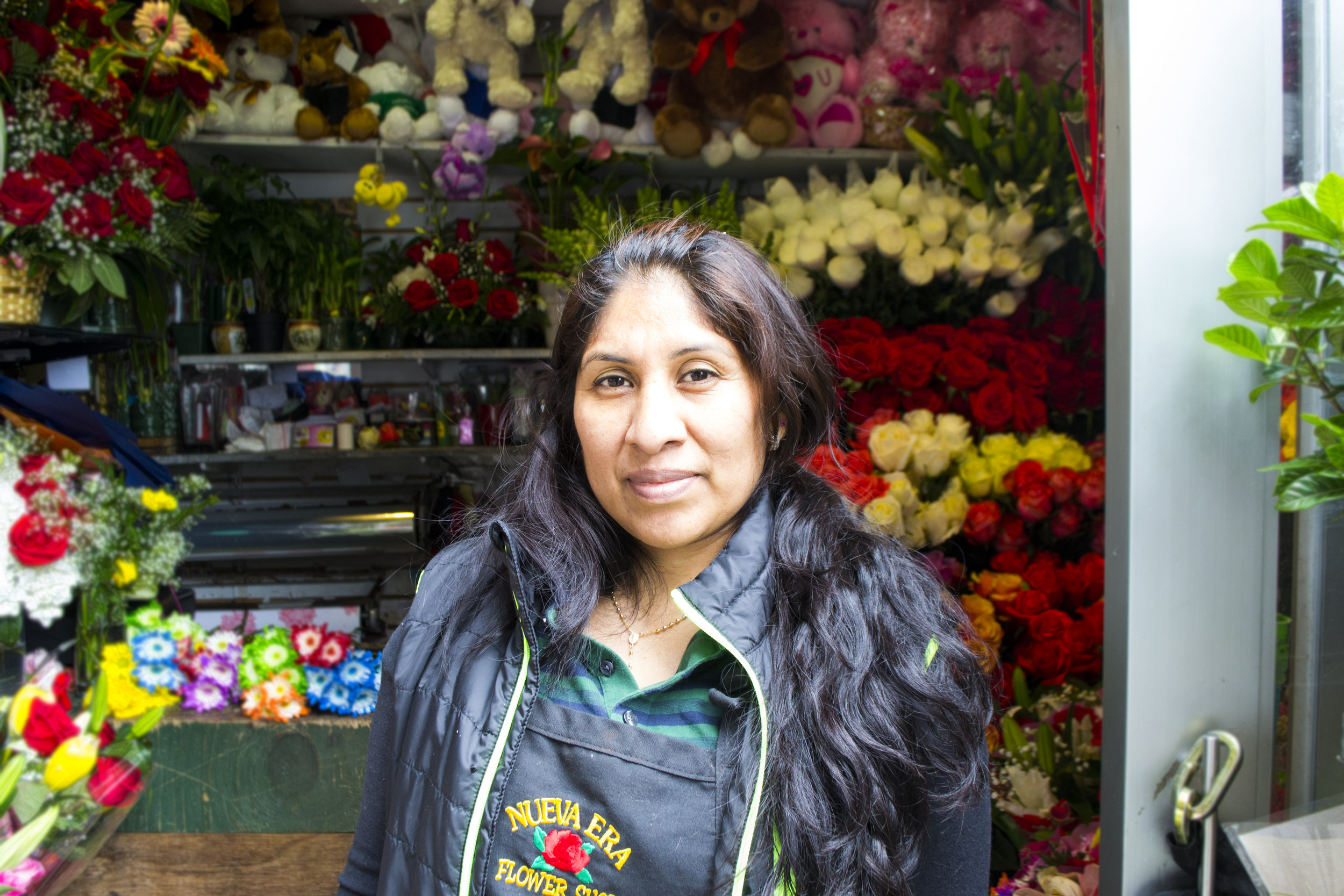 Maria, flower shop owner and Grameen America microloan borrower / Photo courtesy of Grameen America