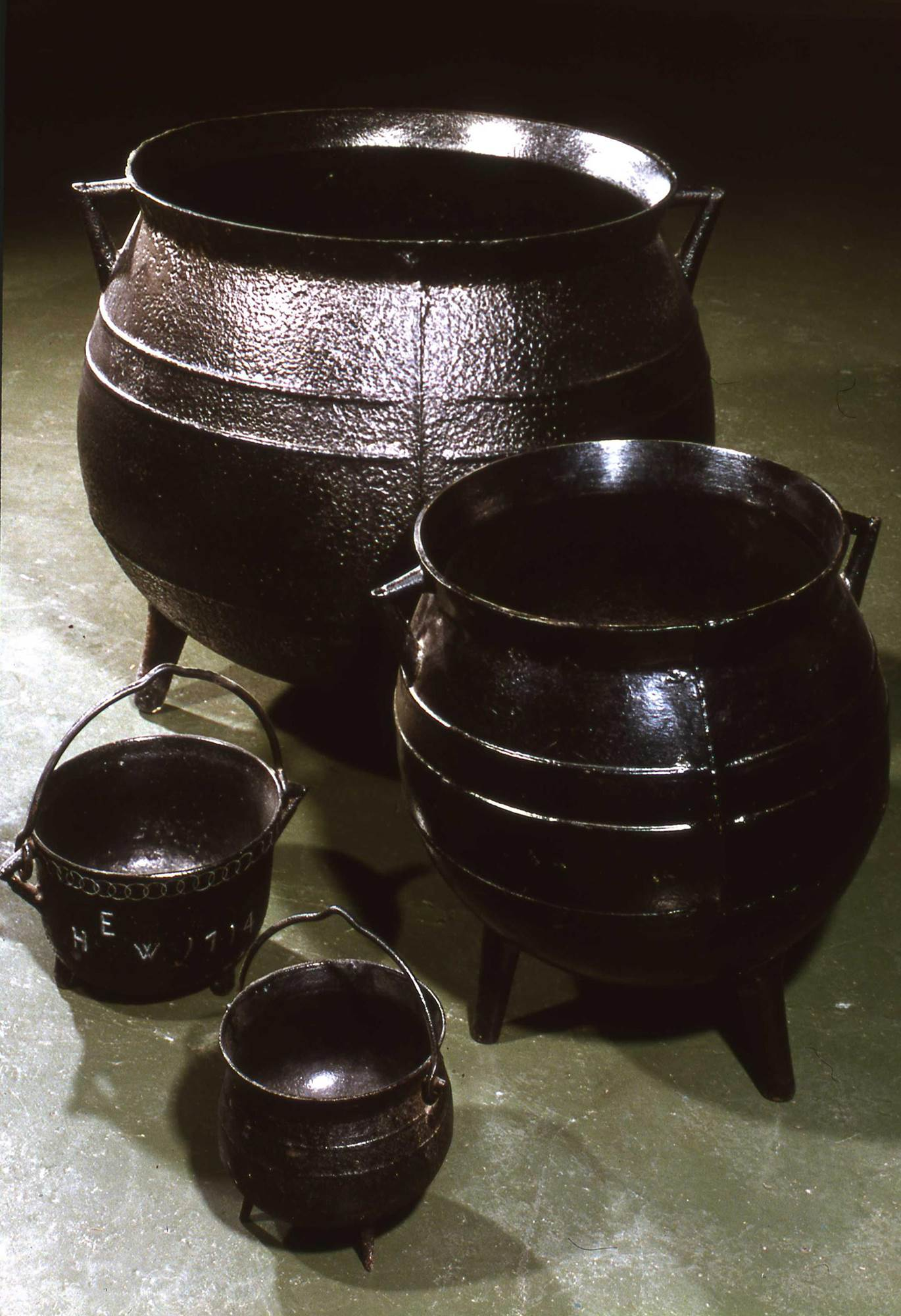 18th century cast iron cooking pots. From the Darby collection, Ironbridge Museum, Coalbrookedale, England.