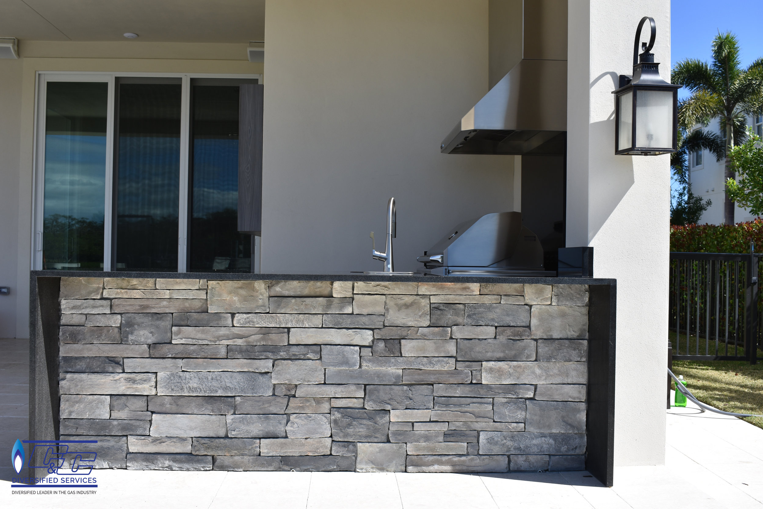 NatureKast Weatherproof Cabinetry with Ledger Style Stone underneath Bar Countertop