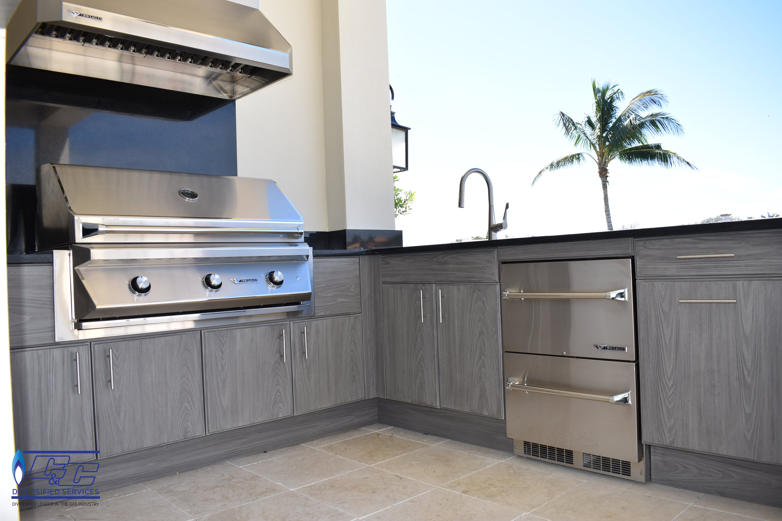 """NatureKast Weatherproof Cabinetry with Twin Eagles 42"""" Grill, Vent Hood, and Outdoor Two-Drawer Refrigerator. Stainless Steel Under-Mount Sink with Faucet"""