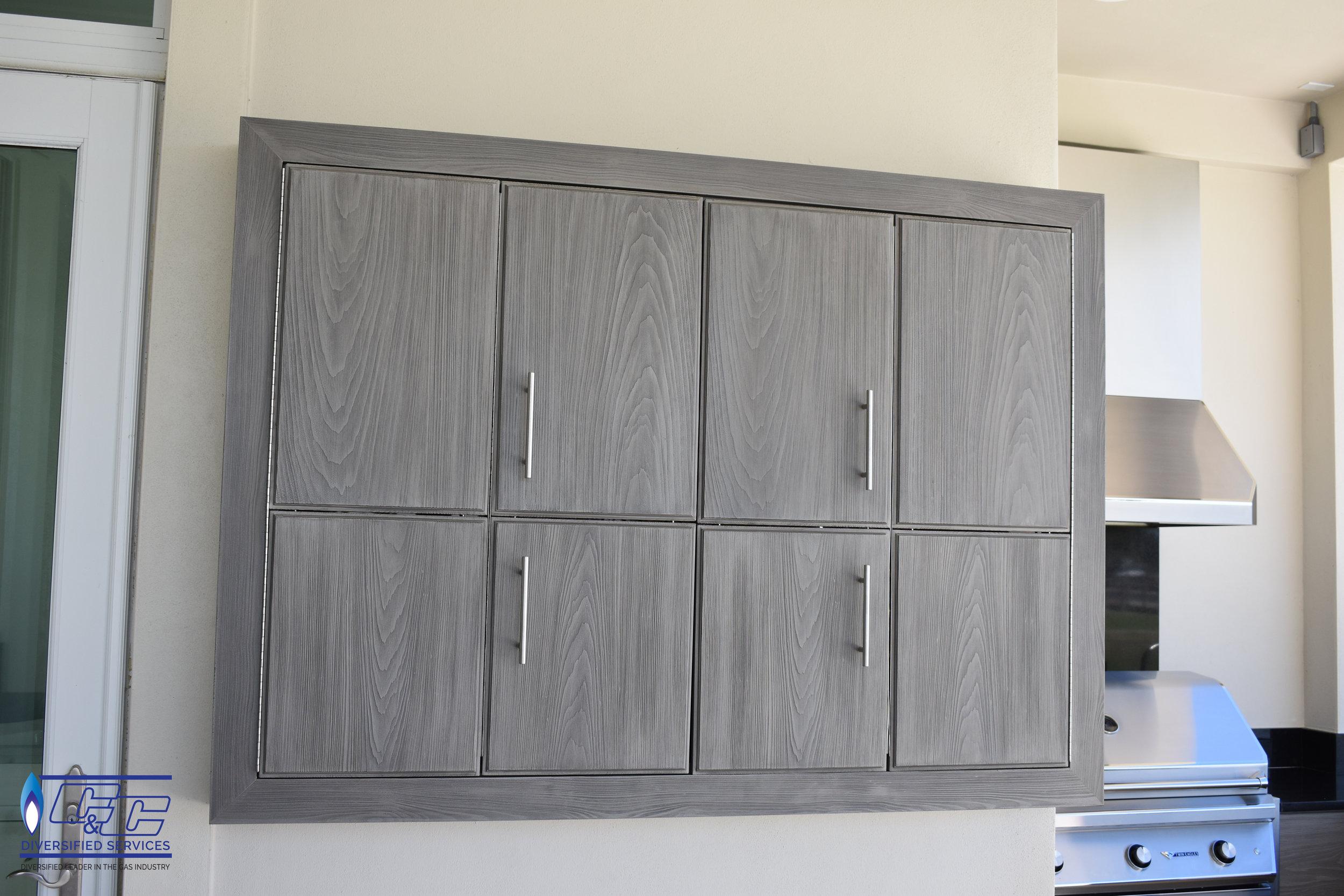 NatureKast Weatherproof Cabinetry in Fossil Gray Bi-fold TV Cabinet