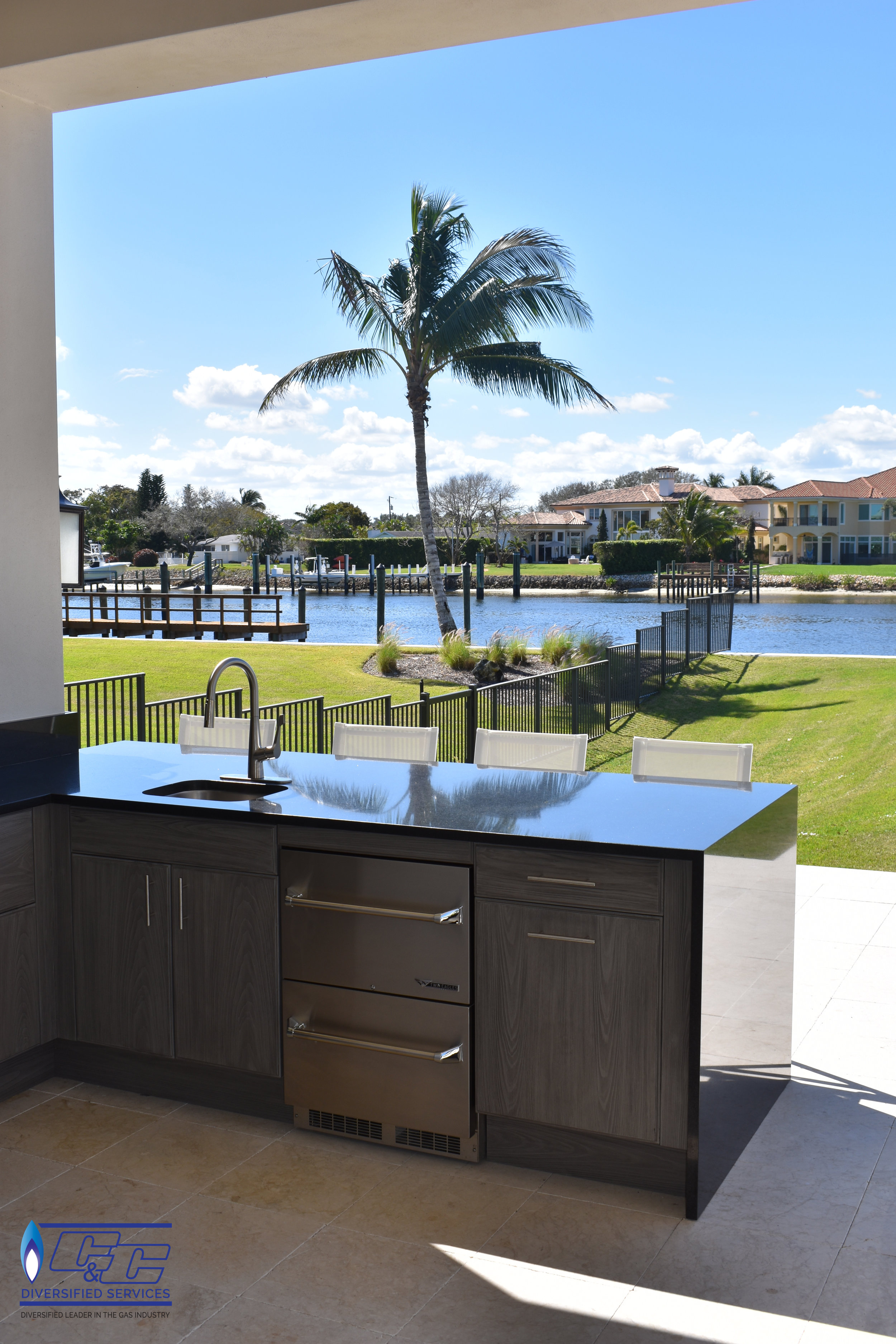 NatureKast Weatherproof Cabinetry in Fossil Gray with a Beautiful Granite from our Showroom Selection with a Waterfall Edge