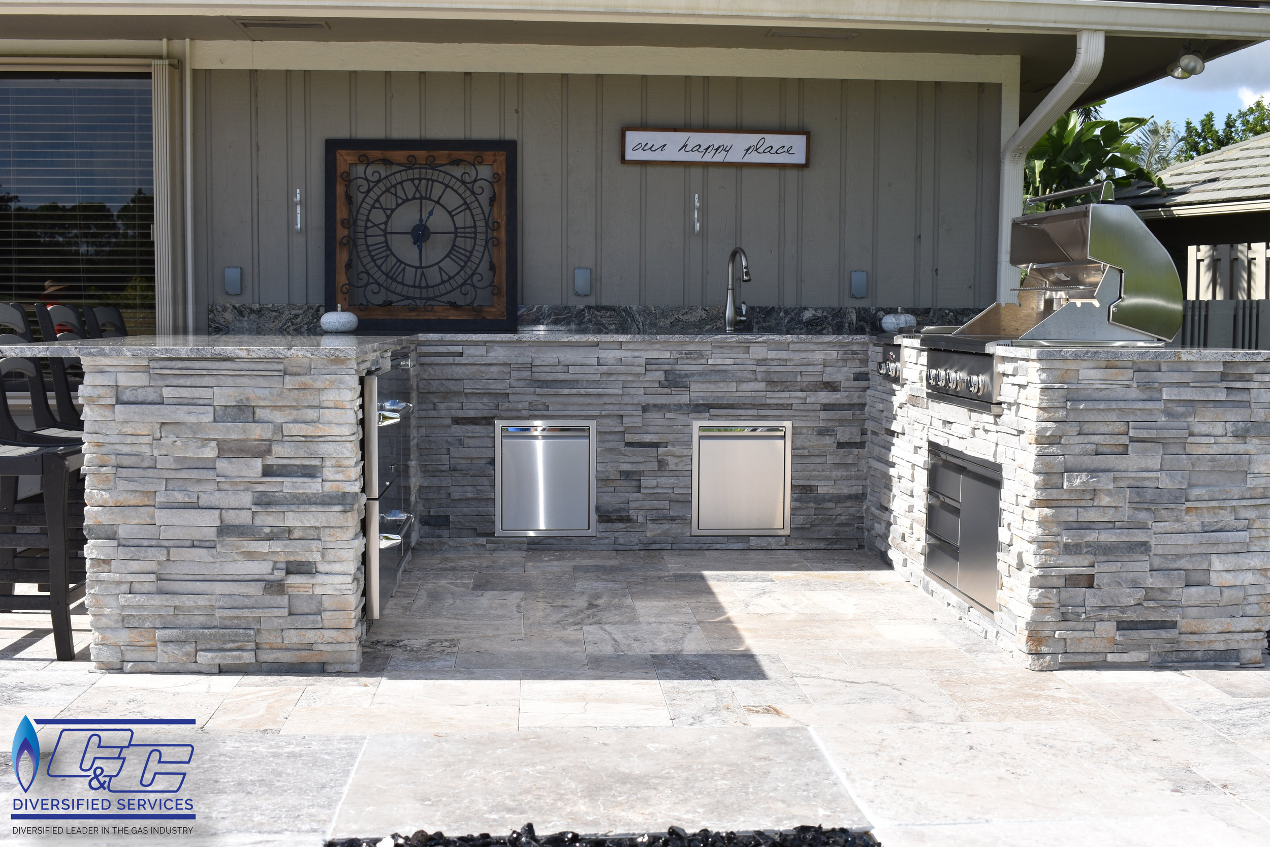 Custom Welded Aluminum L-Shaped Frame with Hardy Board and Stacked Stone Finish