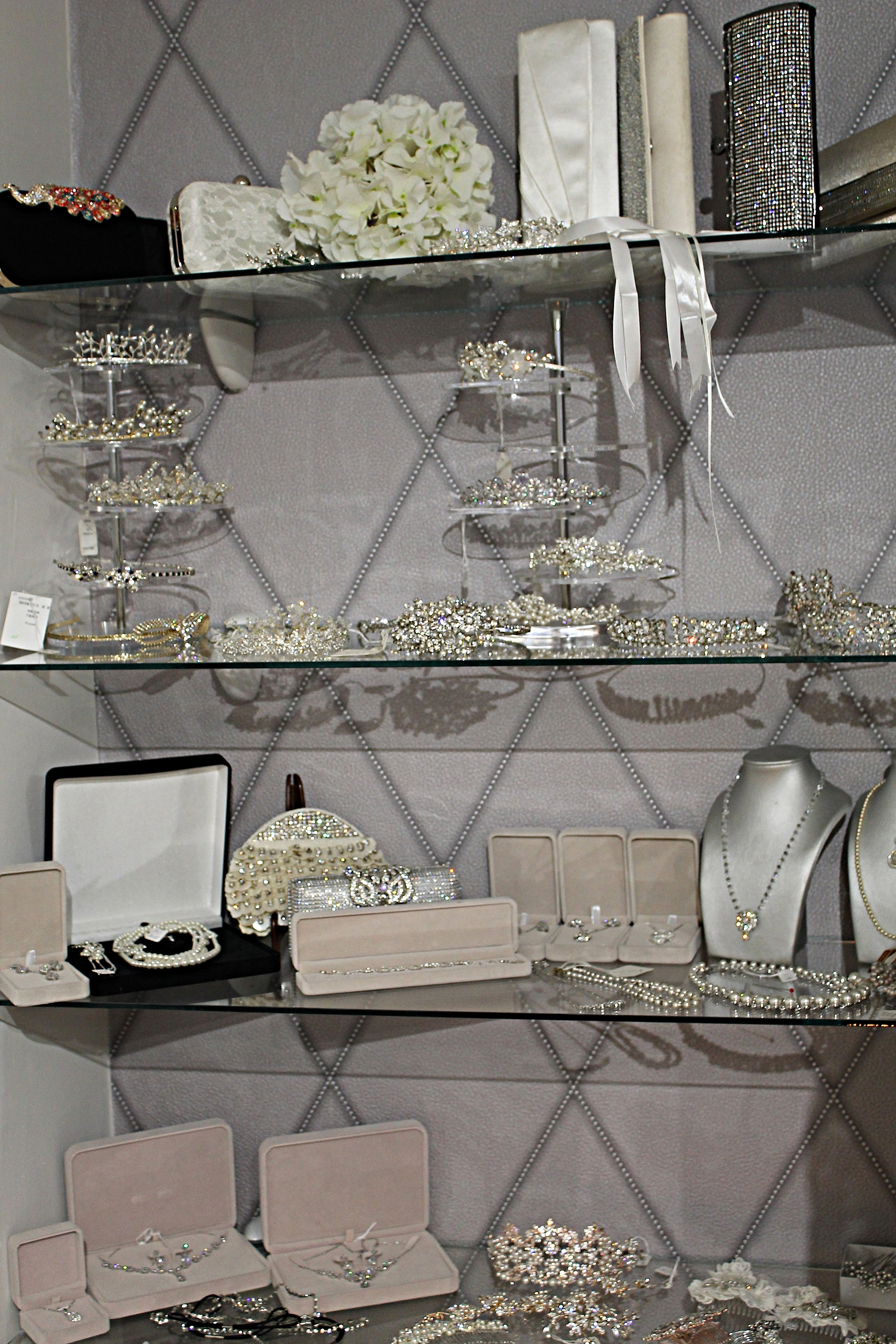 A stunning selection of diamante, crystal, pearl, silver, gold and rose gold accessories, to explore what will match your choice beautifully. Featuring belts, necklaces, earrings, headdresses, combs or simple pins, the selection will help you to achieve several different looks.