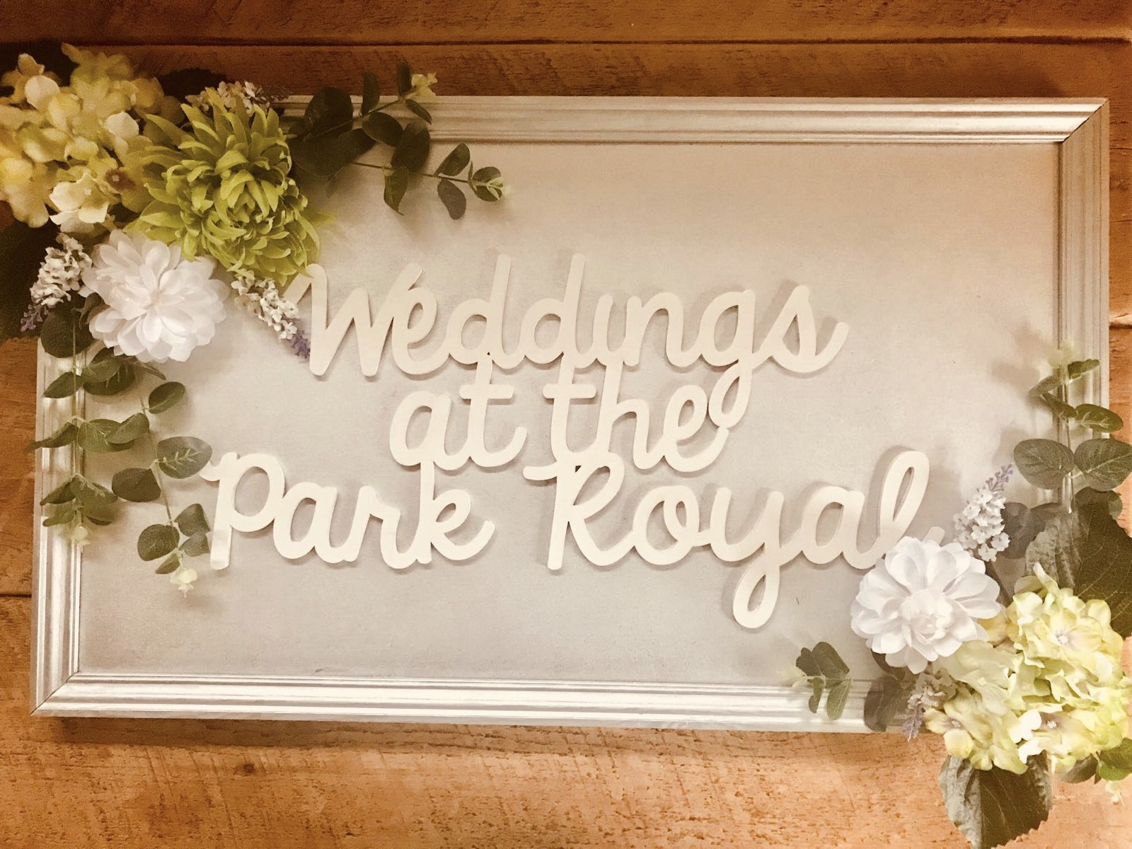 Florals can be a beautiful way to accentuate your event signage. This is a piece designed and Handmade by Festival HQ by our own fair hands!