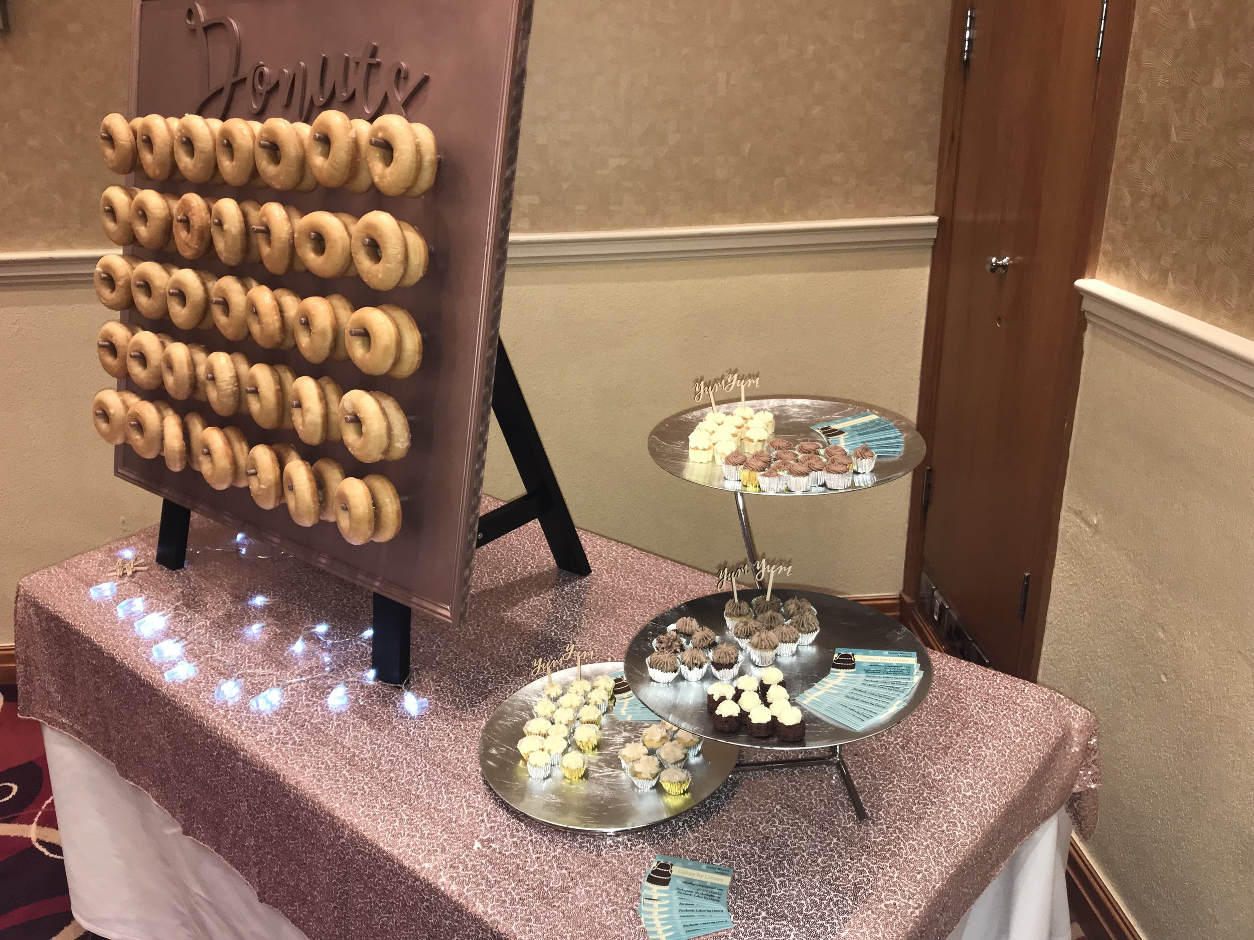 One of our latest pieces, a Donut Wall with the capability of holding 70 Donuts. This particular piece can be customised in any colour or natural wood, with the Donuts sign in any chosen font. It can be floral swagged in the corners to pull your theme together.  This particular piece is £45 to hire the unit or £100 fully loaded with 70 donuts and 10 spares for top ups (for basic glazed donuts.  There are more donut options that can come at a higher cost.