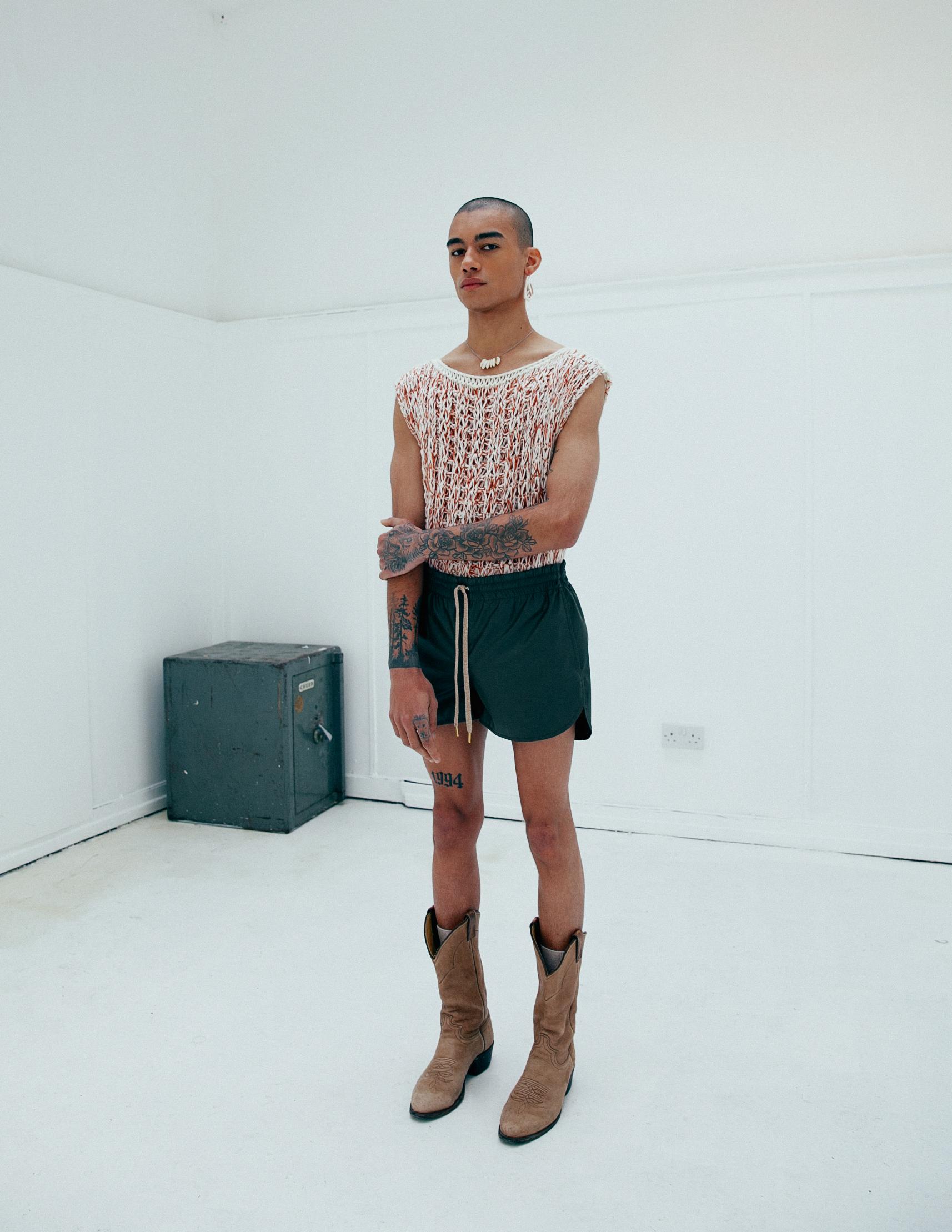 White Knit Top: Market Carter | Shorts: Julian Zigerli | Boots: Window 00 | Jewelry: Stylist's Own