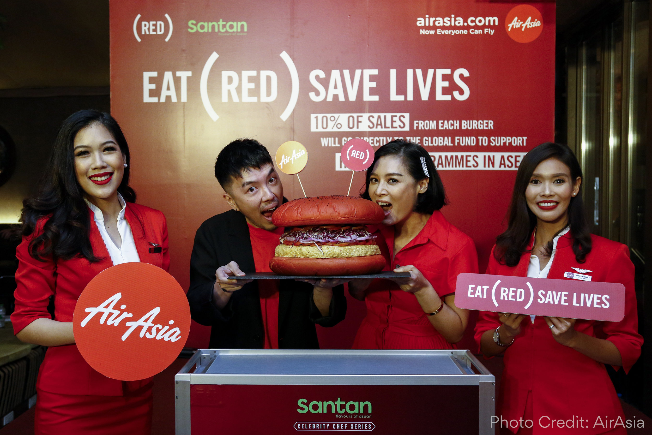 Hong Thaimee and AirAsia team members introducing the INSPI(RED) Burger at the July 2nd launch event in Bangkok, Thailand.