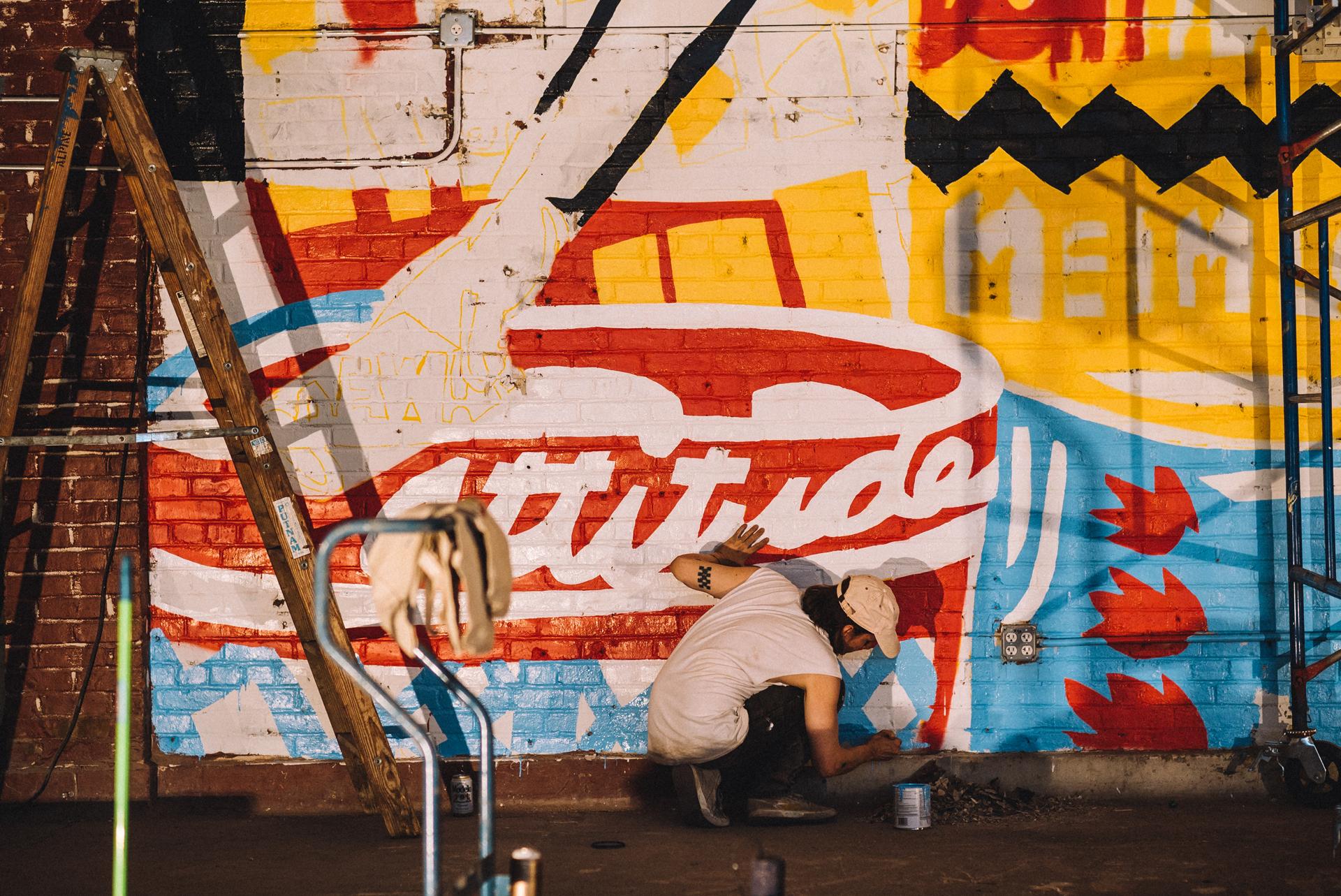 "Adam Lucas, Painting ""Don't Hassle Me"" mural, Market Surplus, New York City, June 2017"