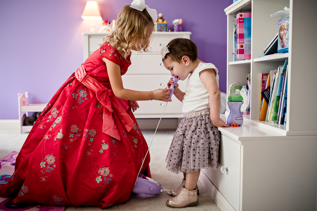 - A priceless moment between sisters as they play dress up and sing their favorite Disney songs; standing so small and so innocent.