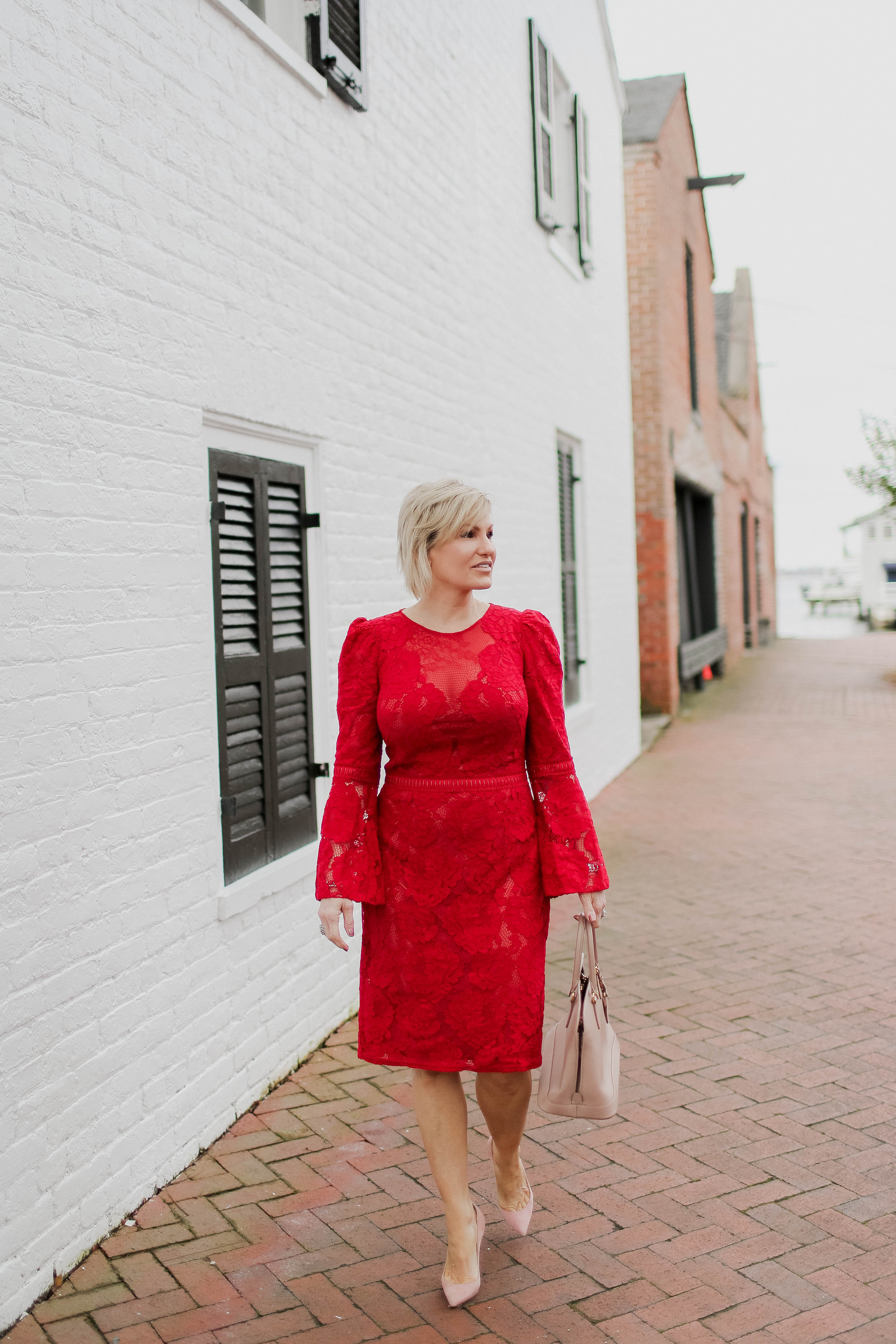 The soft lace and bell sleeves give this dress an ultra feminine look, making it the perfect dress for a Valentine's Day dinner. (Red dress:  here ) (Black dress:  here ) Complete the look: Christian Louboutin:  here , Similar look:  here . Handbag: Prada:  here , Similar look:  here .