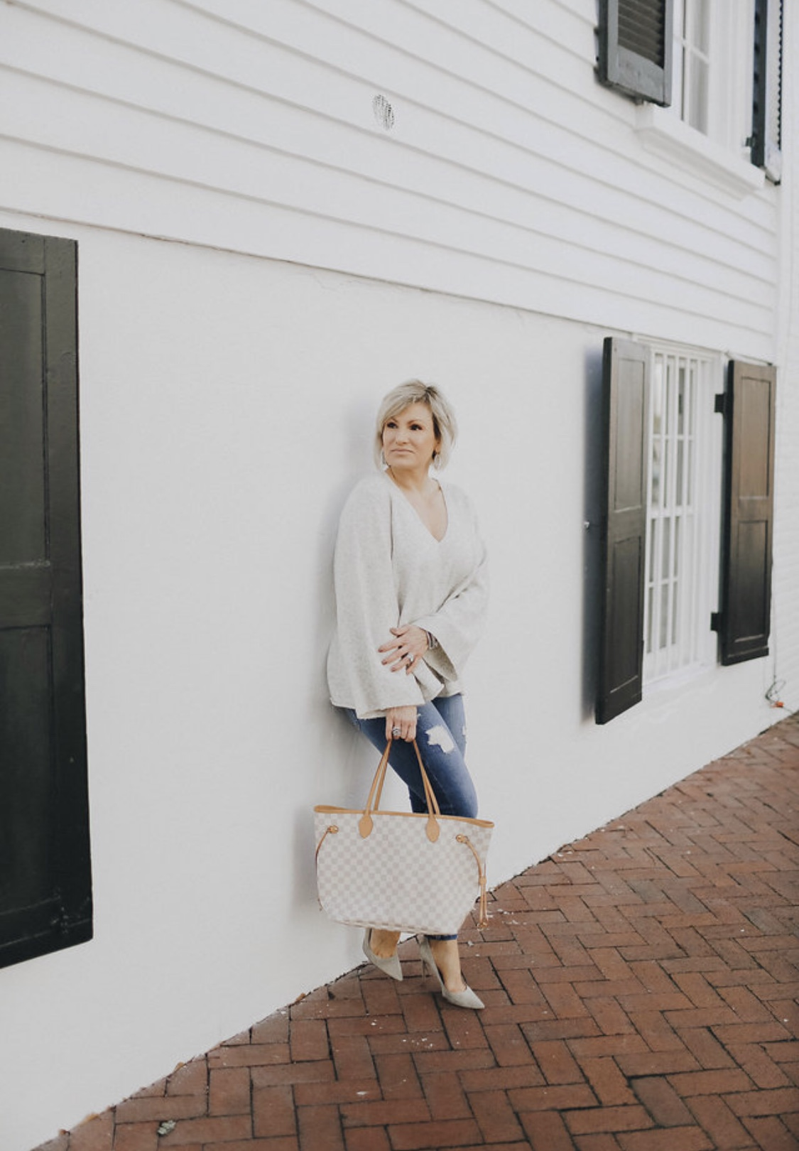 Stocking up on lighter weight sweaters to transition to spring. Easy to throw on a cardigan or heavier jacket for evenings. This  sweater  comes in four colors and is currently on sale; jeans  here , shoes  here  or similar style  here ; handbag similar style  here .