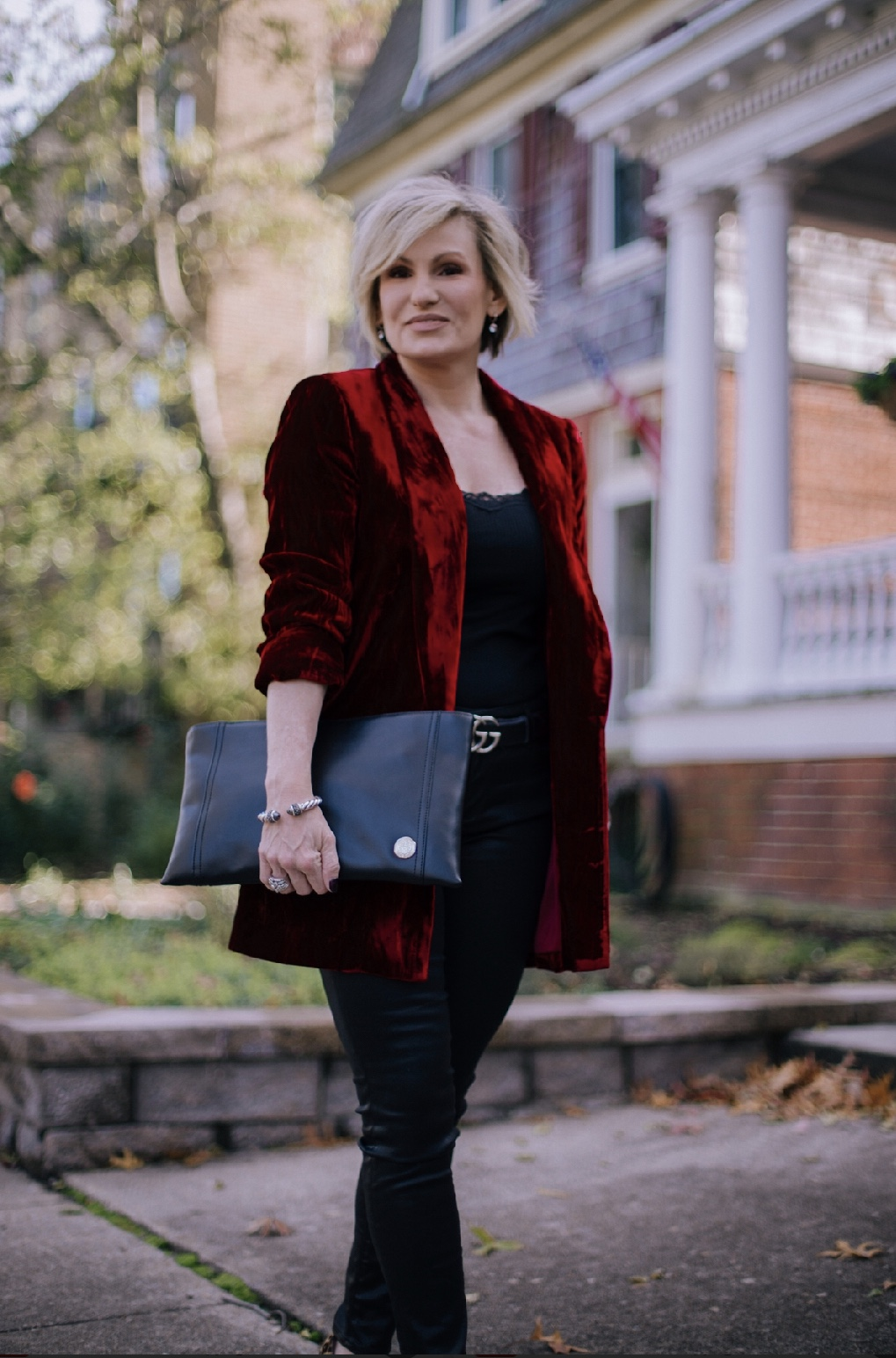Velvet is a fall favorite and stands the test of time. Slipping a vibrant velvet jacket over an all-black palette adds instant richness and texture. Throw on your favorite animal print shoes and you have a simple but elegant holiday look. Shop this look  here .