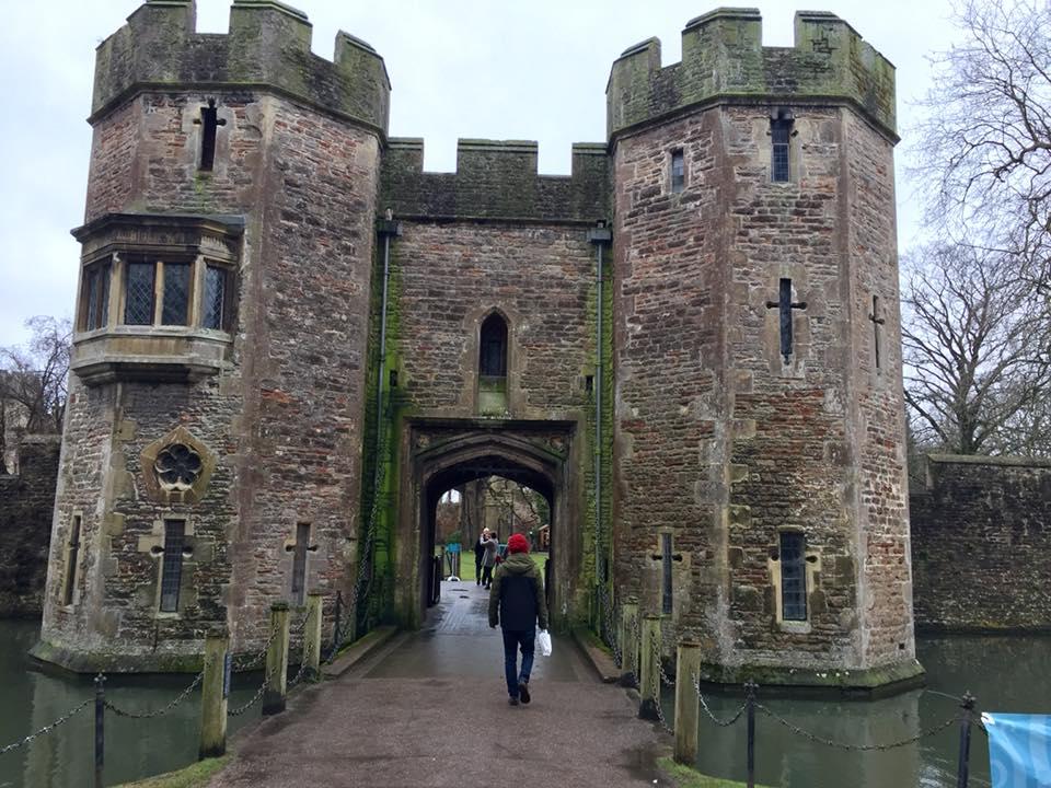Luc walking across the drawbridge