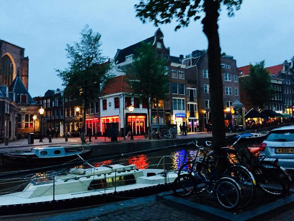 Looking at the outskirts of the red light district from across a canal