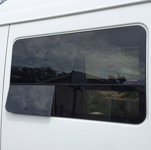 Windows - CR Laurence Rear Door Windows have been added to our Vanz as well as Driver and Passenger Side All Glass Frameless Windows with Operable T Vents for fresh air. 28% Dark Gray Glass for privacy.