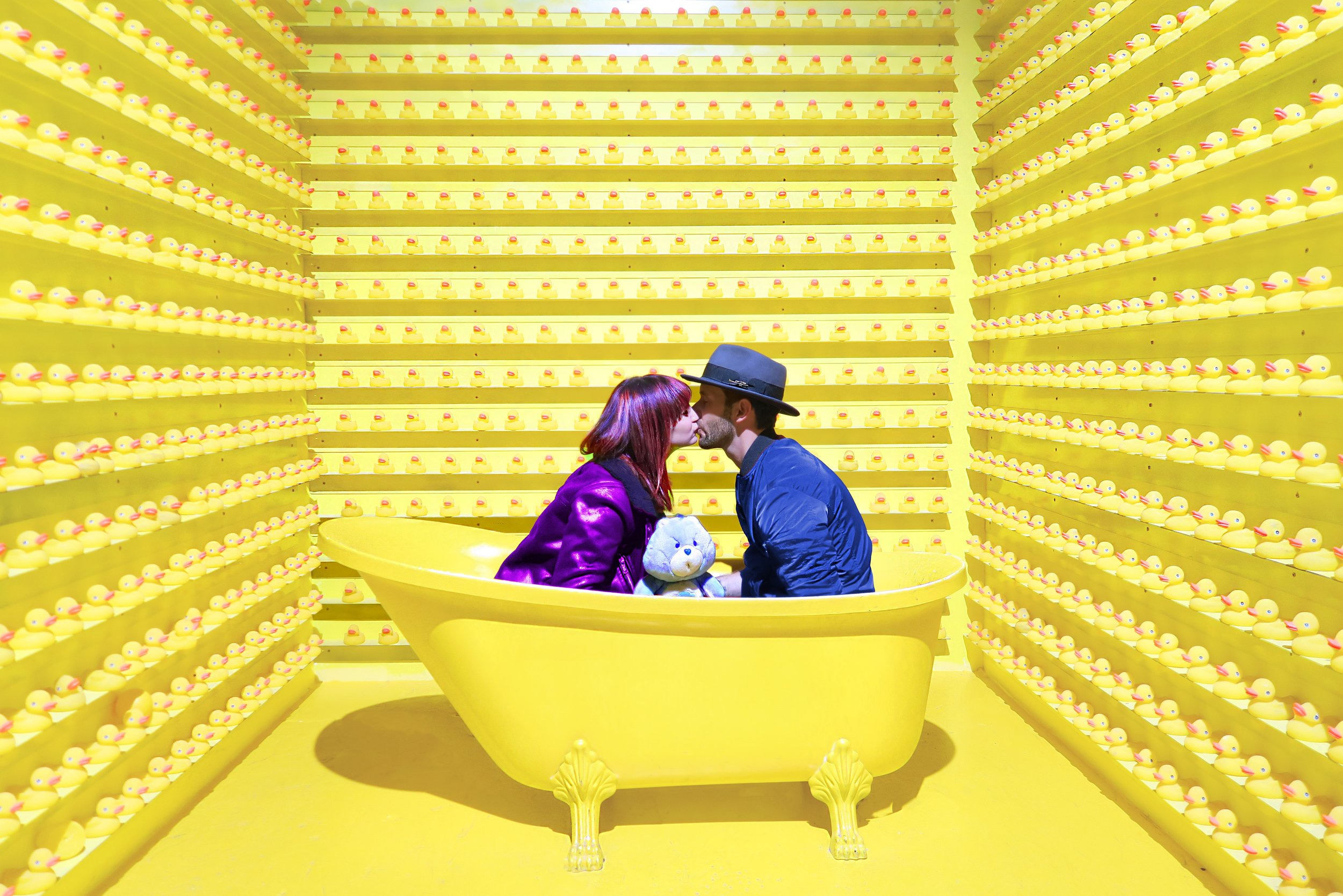 Man and women in a yellow bath