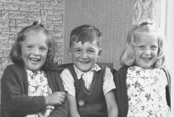 "Sonia Jenkins – ""Me Circa 1962 with my twin sister and brother. Check out those dresses - almost as good as my Cowgirl Cossie for the MoonWalk."""