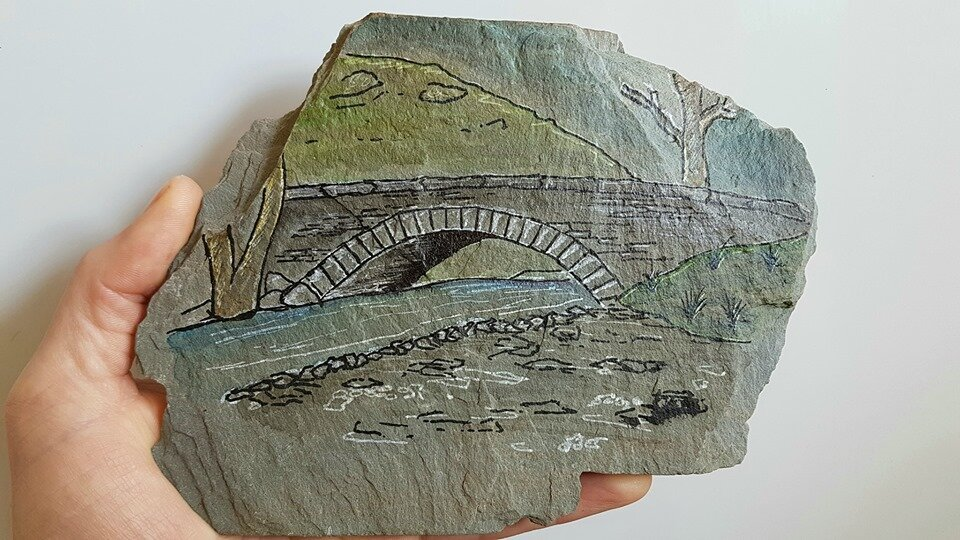 This bridge is near Coniston and drawn out on local Lakes slate that I found on a spoil heap Matt Bowker