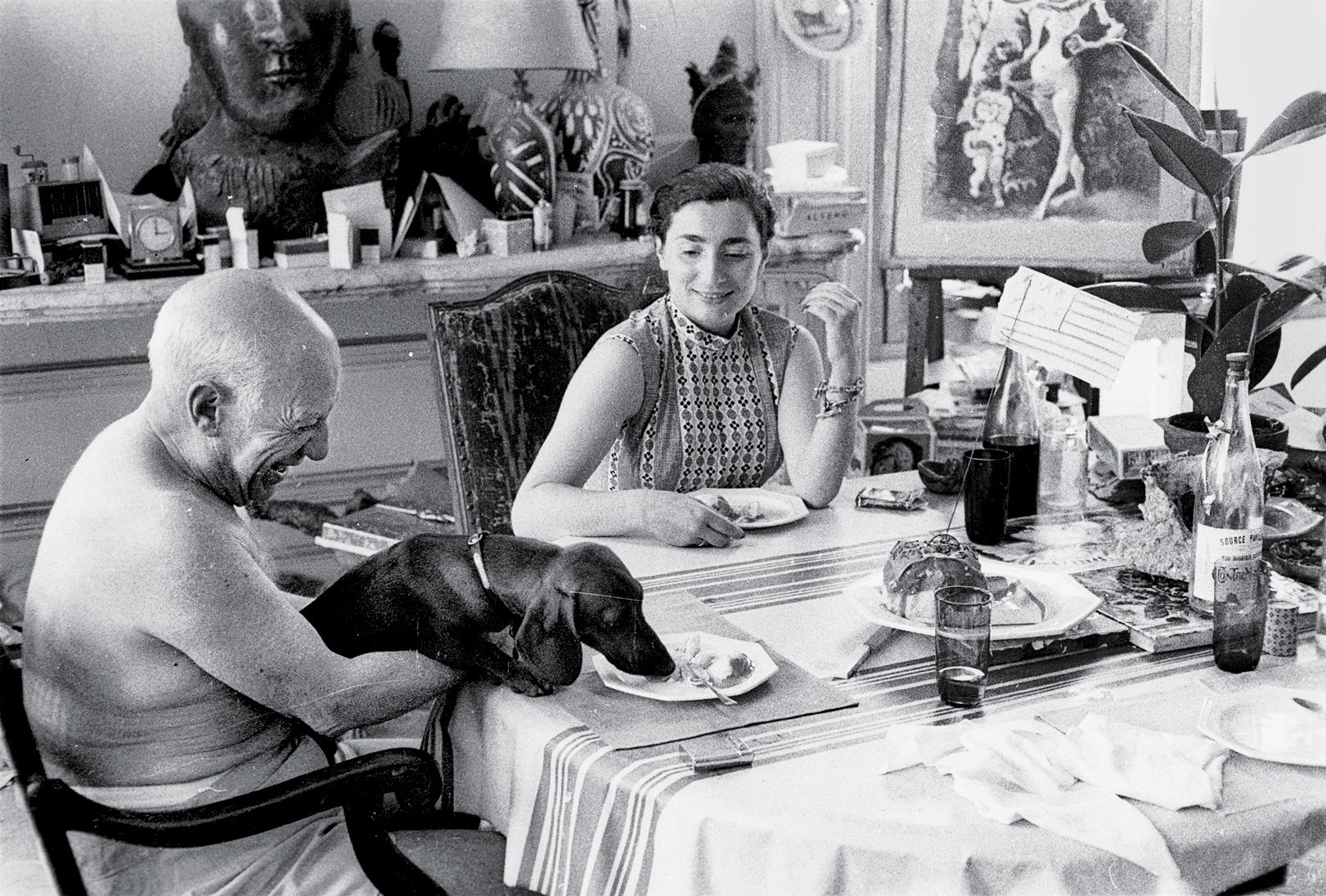 Picasso and Jacqueline (his second wife) sharing lunch with Lump. Photograph: David Douglas Duncan, 1957. http://www.nytimes.com/interactive/2013/06/02/t-magazine/02lookout-picasso.html