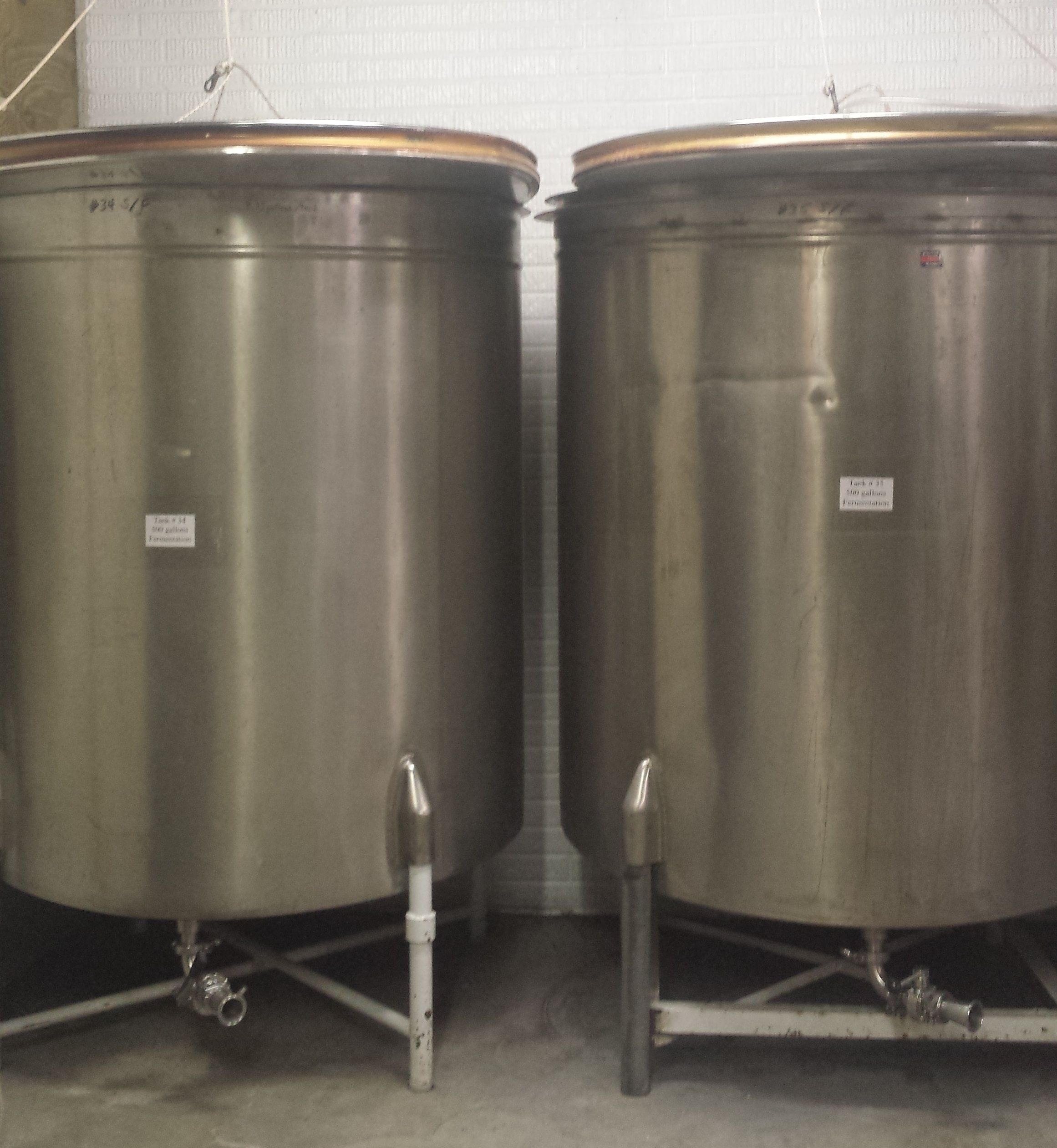 2 - 500 gallon stainless steel fermentation tanks w/floating lids $300 each