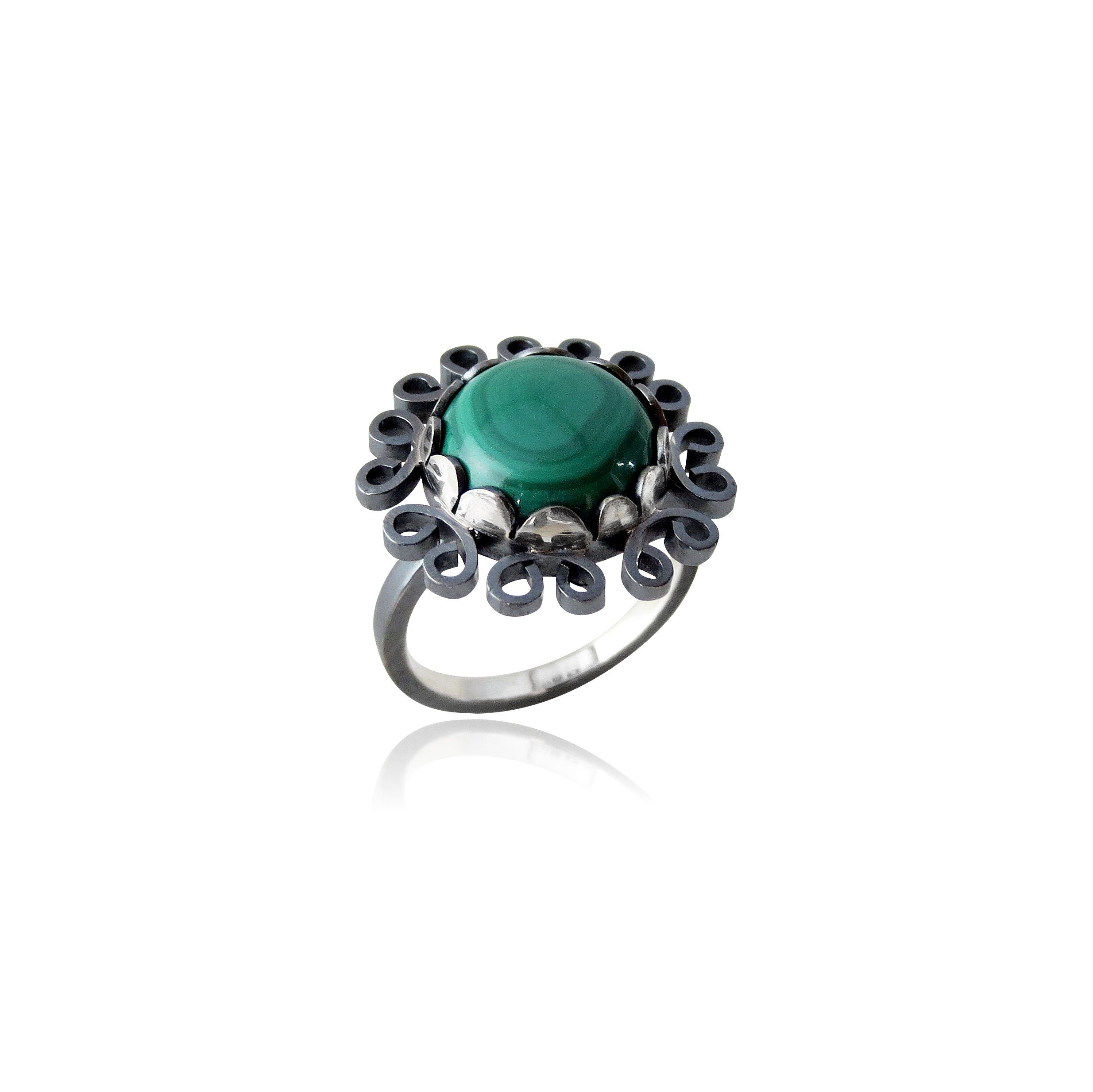 Oxidized sterling silver with malachite.