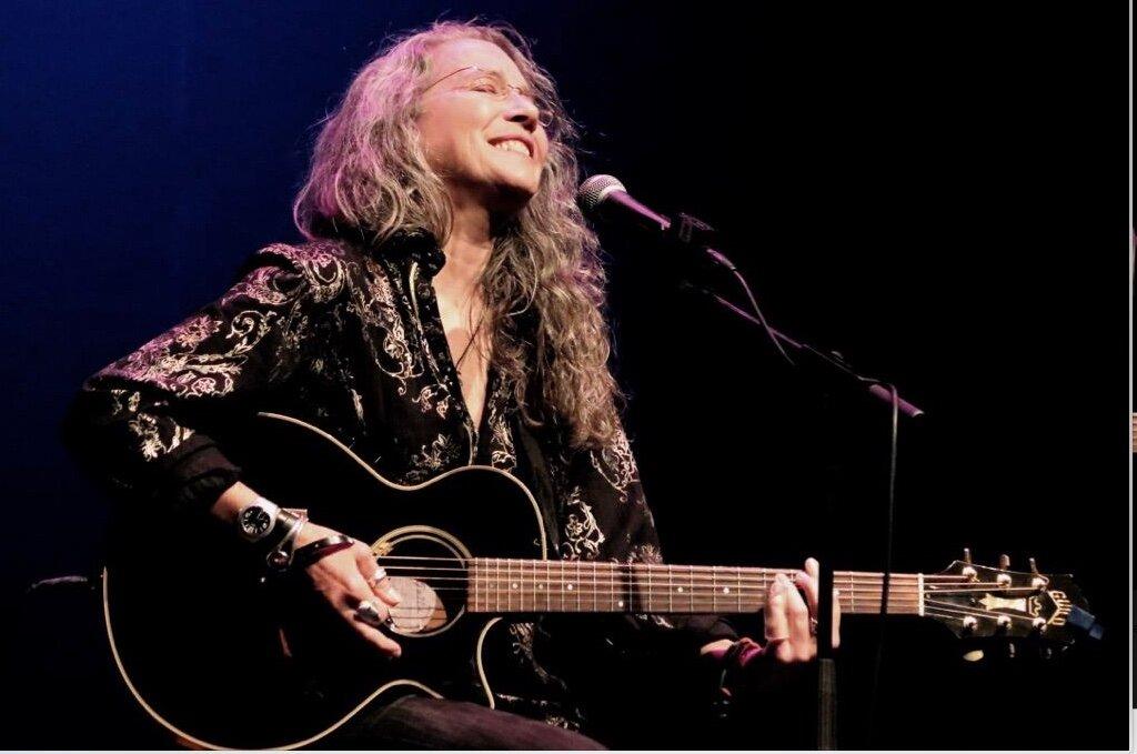 Cathy Grier_DCA-acoustic guitar_Bruce Rose image.jpeg