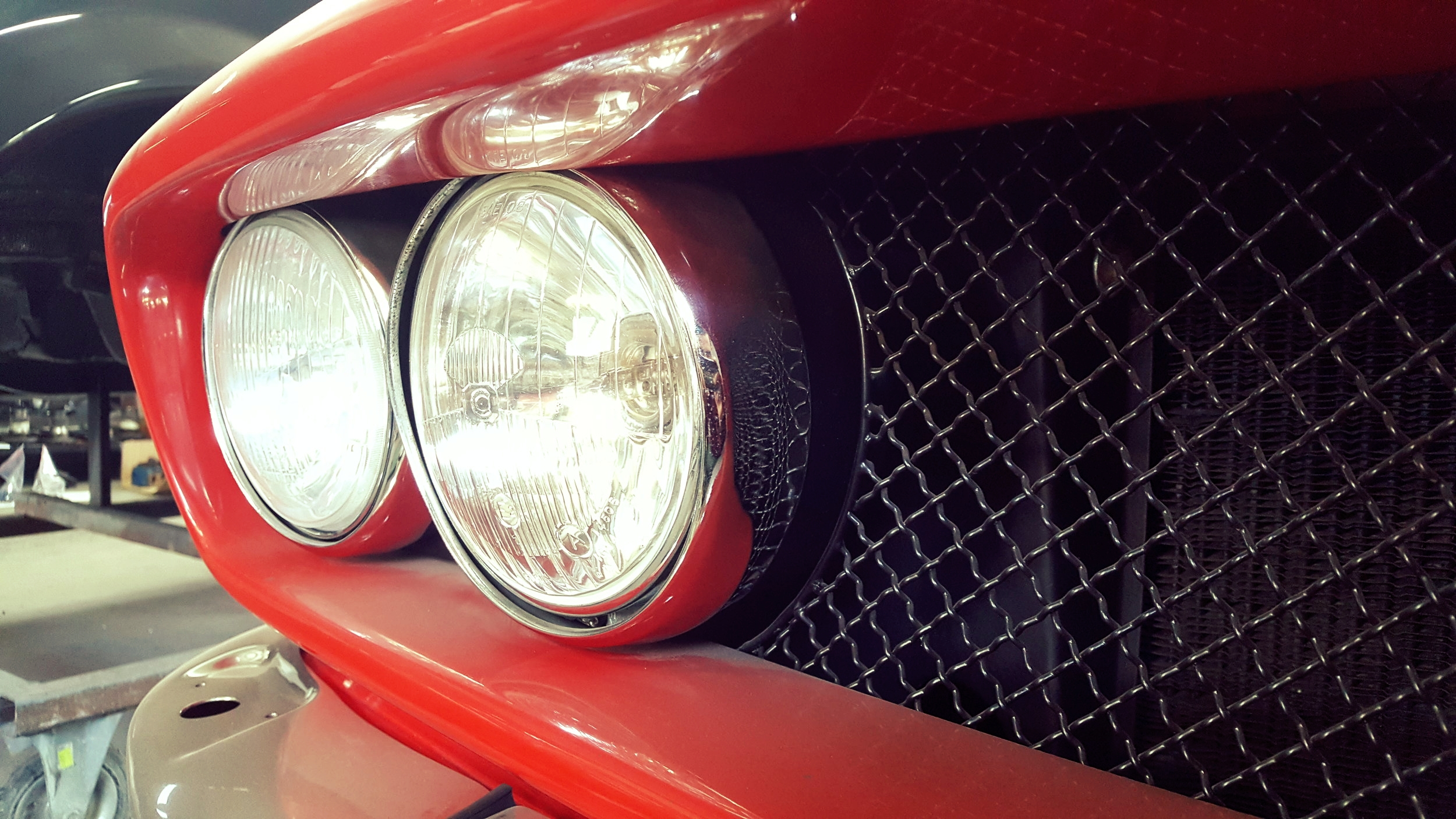 Front lamps and bonnet of an ISO Grifo were reproduced based on pictures.