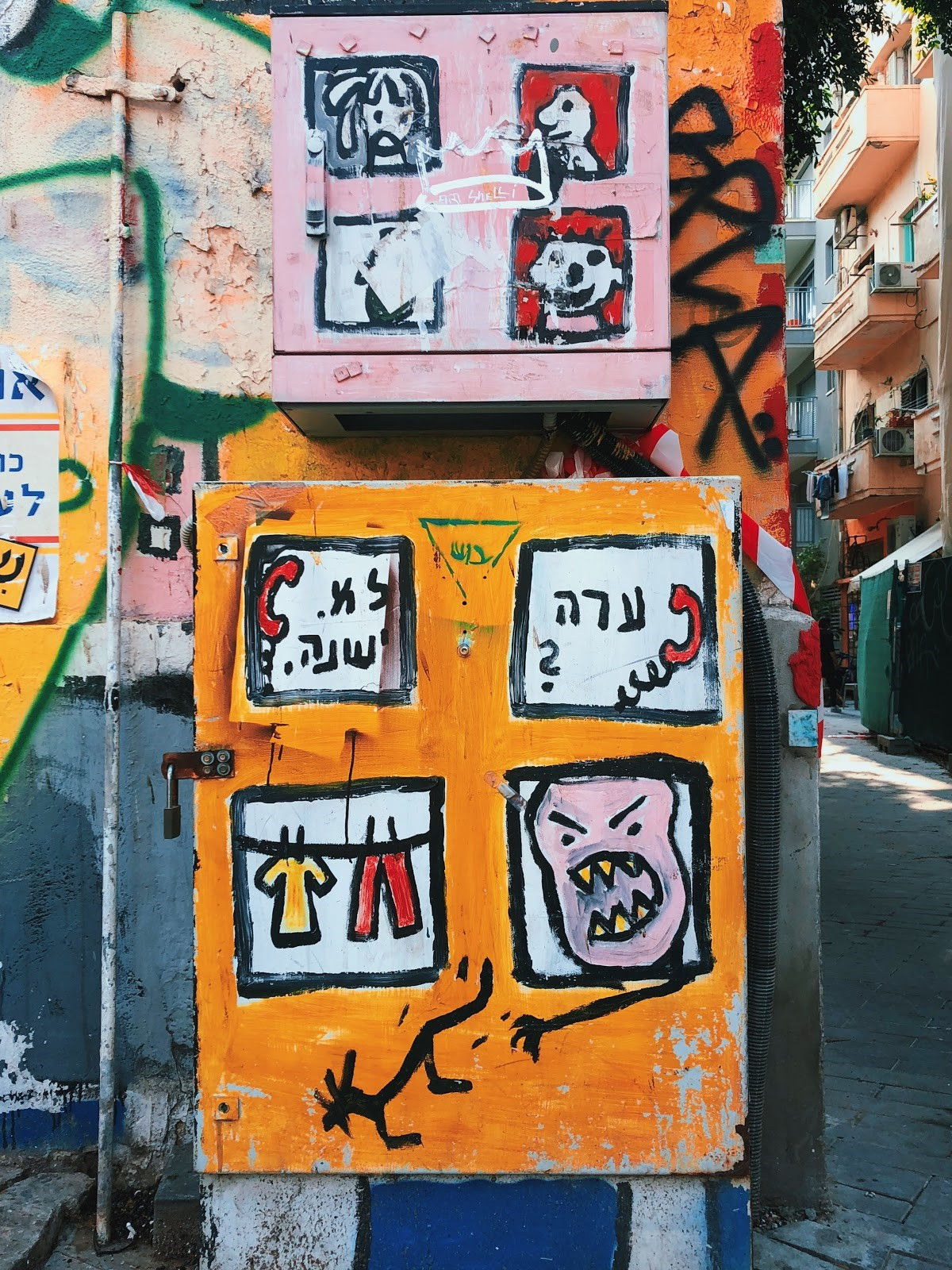 A painted electrical box on a street in Tel Aviv