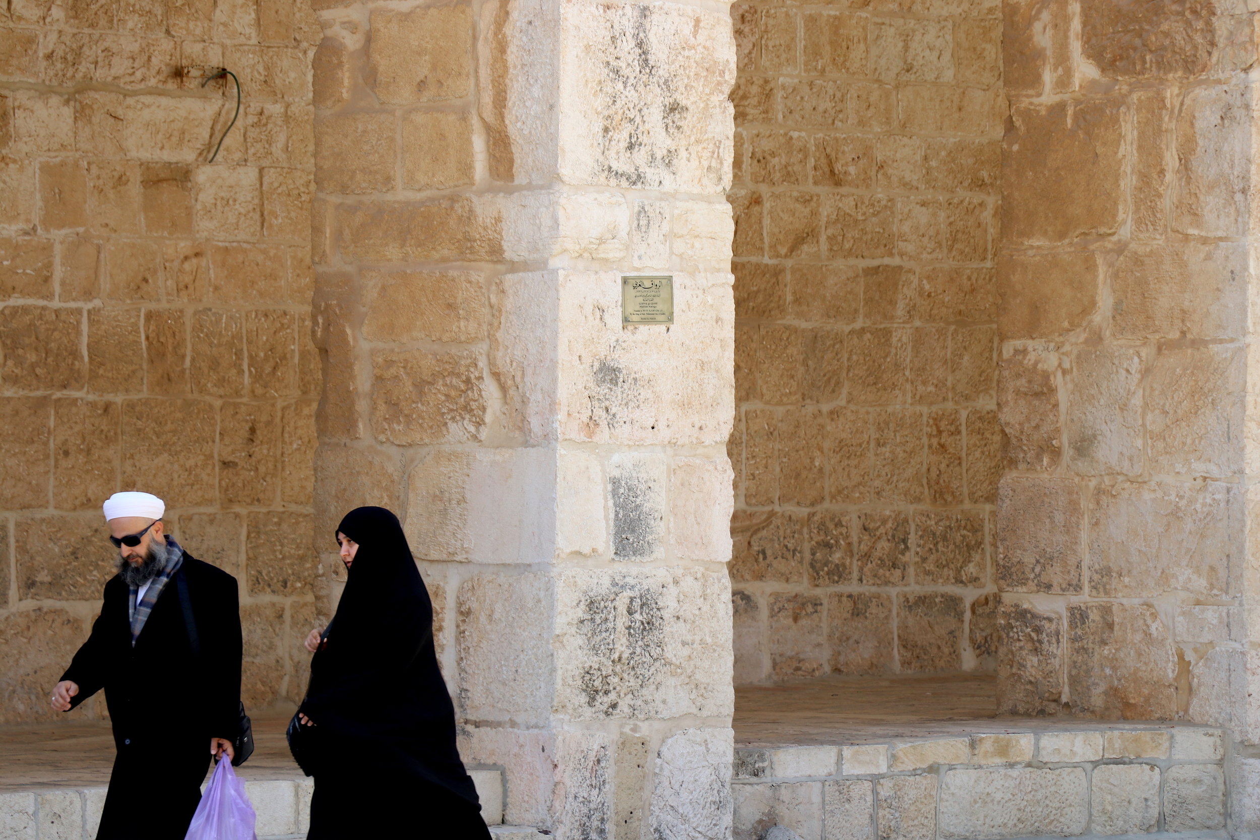 Women walk at the Dome of the Rock in the Old City of Jerusalem. The Islamic shrine is of great significance to Muslims, who believe that Prophet Muhammad's ascendance to heaven started from the rock at the core of the structure. Photo by    Saniya More
