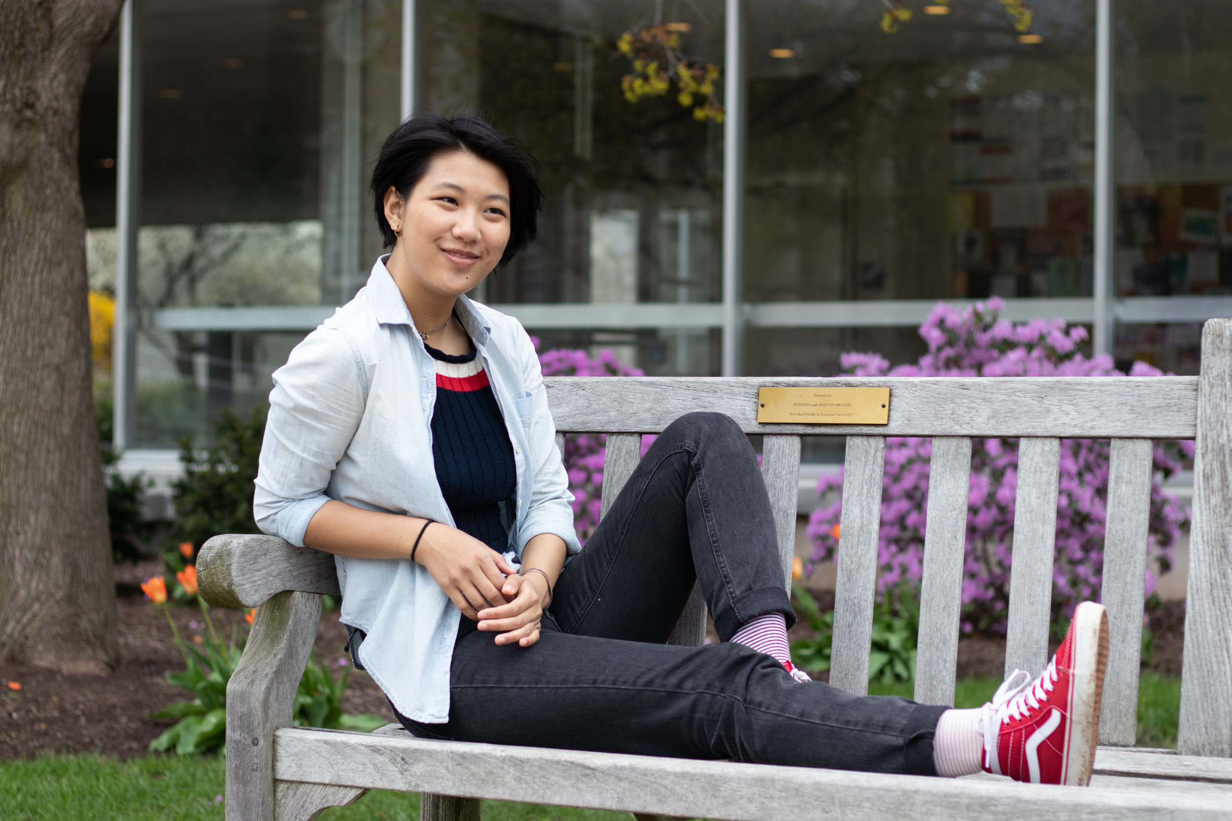 A sophomore film student from Fort Collins, Colorado, Philavahn lounges on a bench in front of H.B. Crouse. Photo by  Marijke Pieters-Kwiers