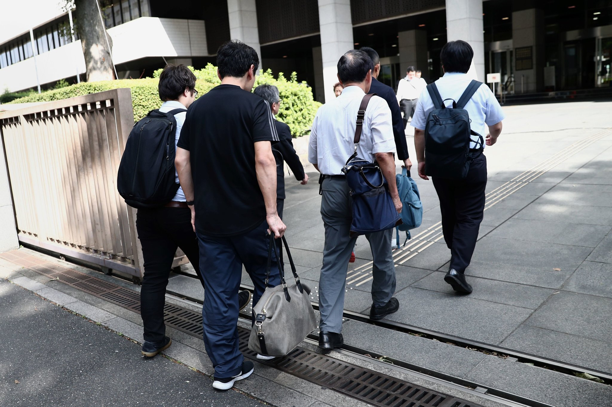 A Japanese man, who has taken paternity leave and been punished, entered a Tokyo court Thursday. Photo courtesy: Behrouz Mehri/Agence and France-Presse/Getty Images