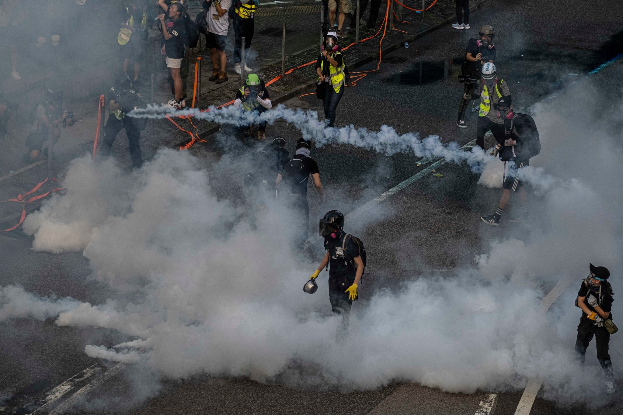 The masked protesters in Hong Kong hurled gasoline bombs at governmental buildings. Photo courtesy: Lam Yik Fei | The New York Times