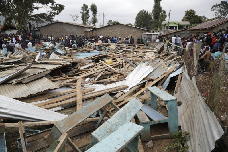 At least seven students died due to the collapse of a Kenya elementary school, prompting conversations about the local building standards. Photo Courtesy: Khalil Senosi | AP