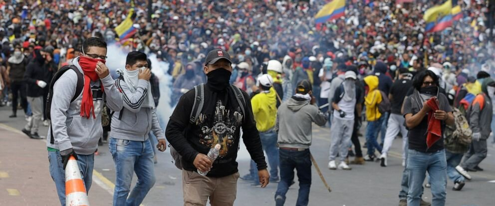 Thousands of indigenous anti-government protesters gather in Ecuador's capital Quito Tuesday. The clashes already led to the president moving his administration out of the city. Fernando Vergara | AP
