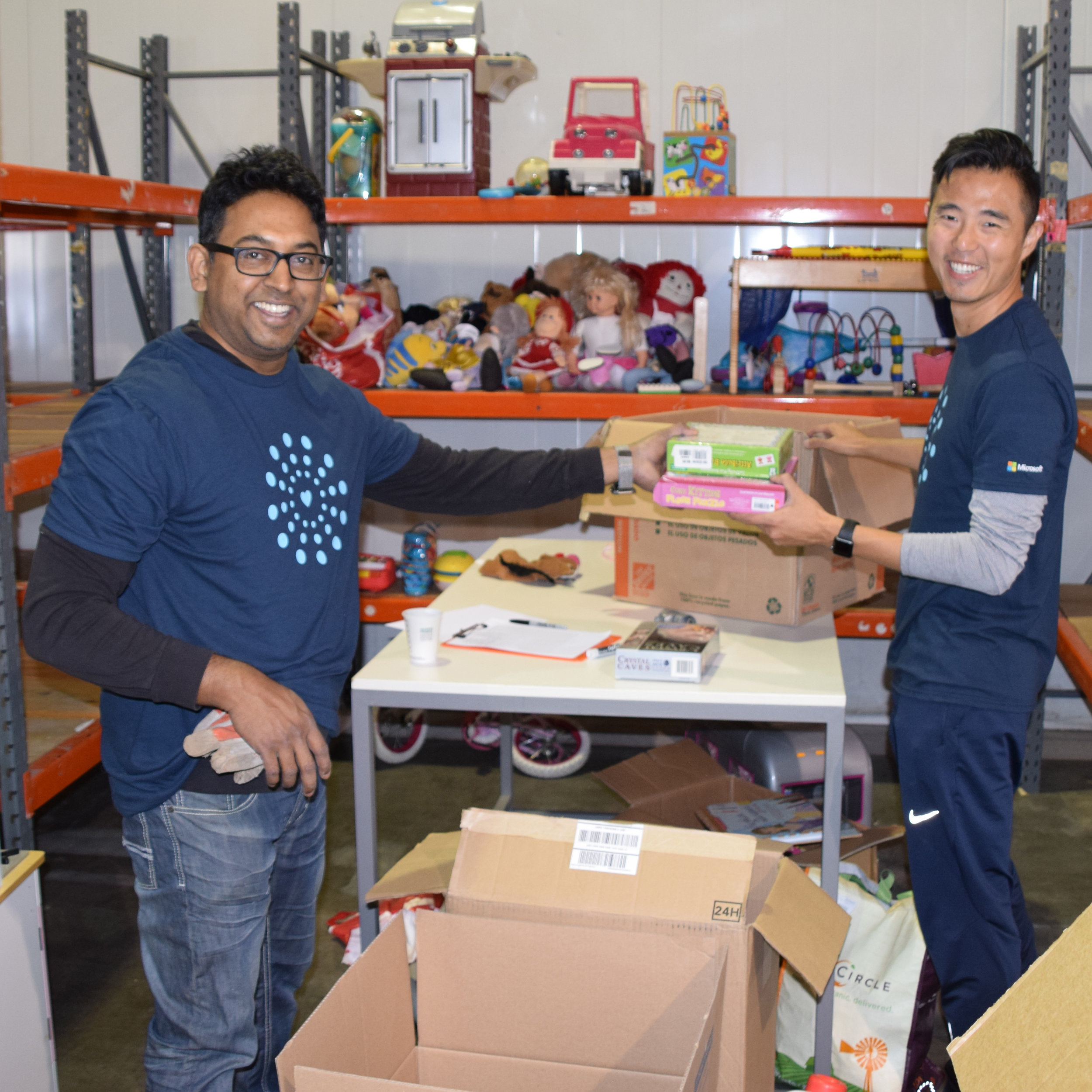 two men volunteering at the Seattle warehouse