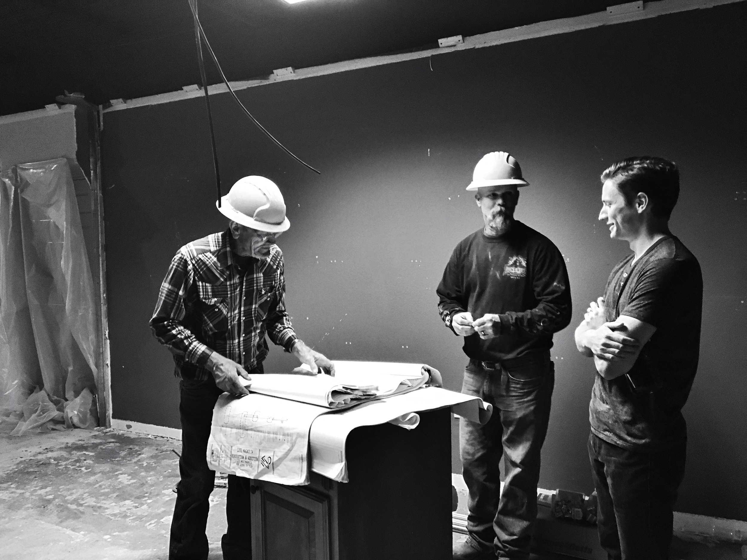 Co-owner Mark chatting with contractors
