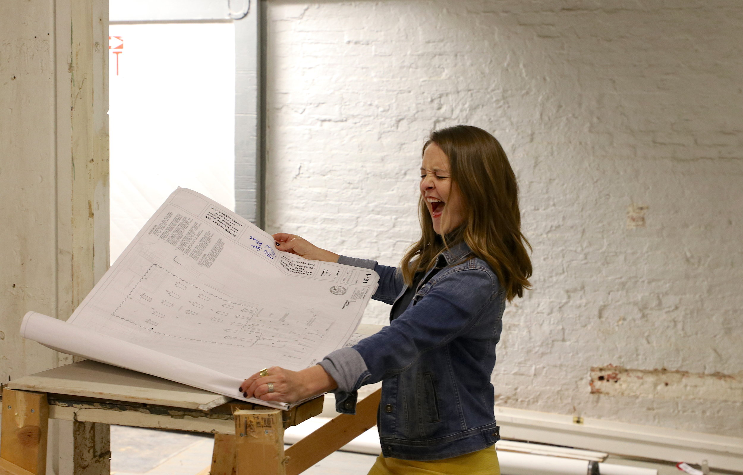 MELT owner Kari reviews blueprints for the new space, absolutely STOKED!