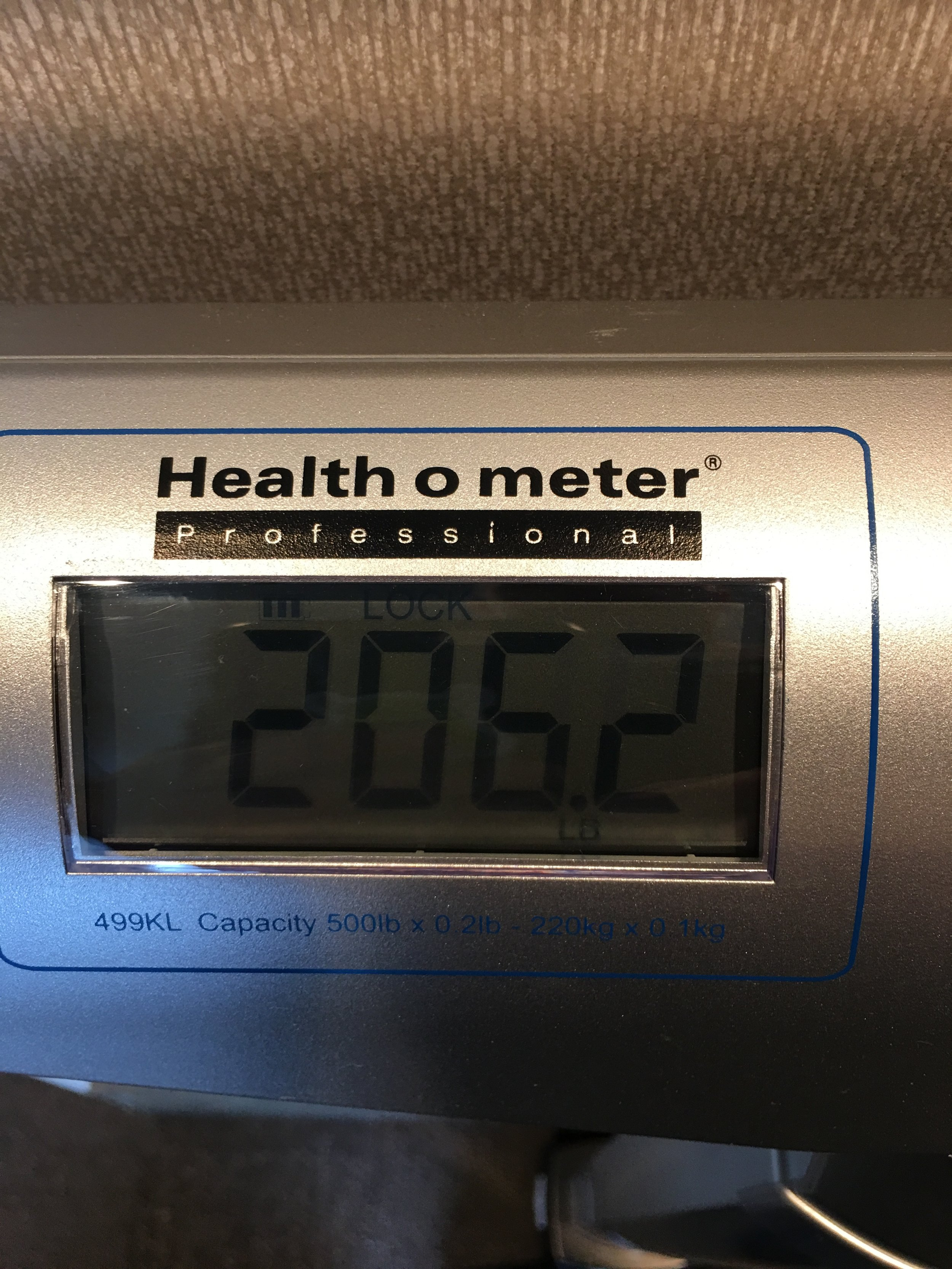 Checking weight on the hotel scale after arriving for the meet.