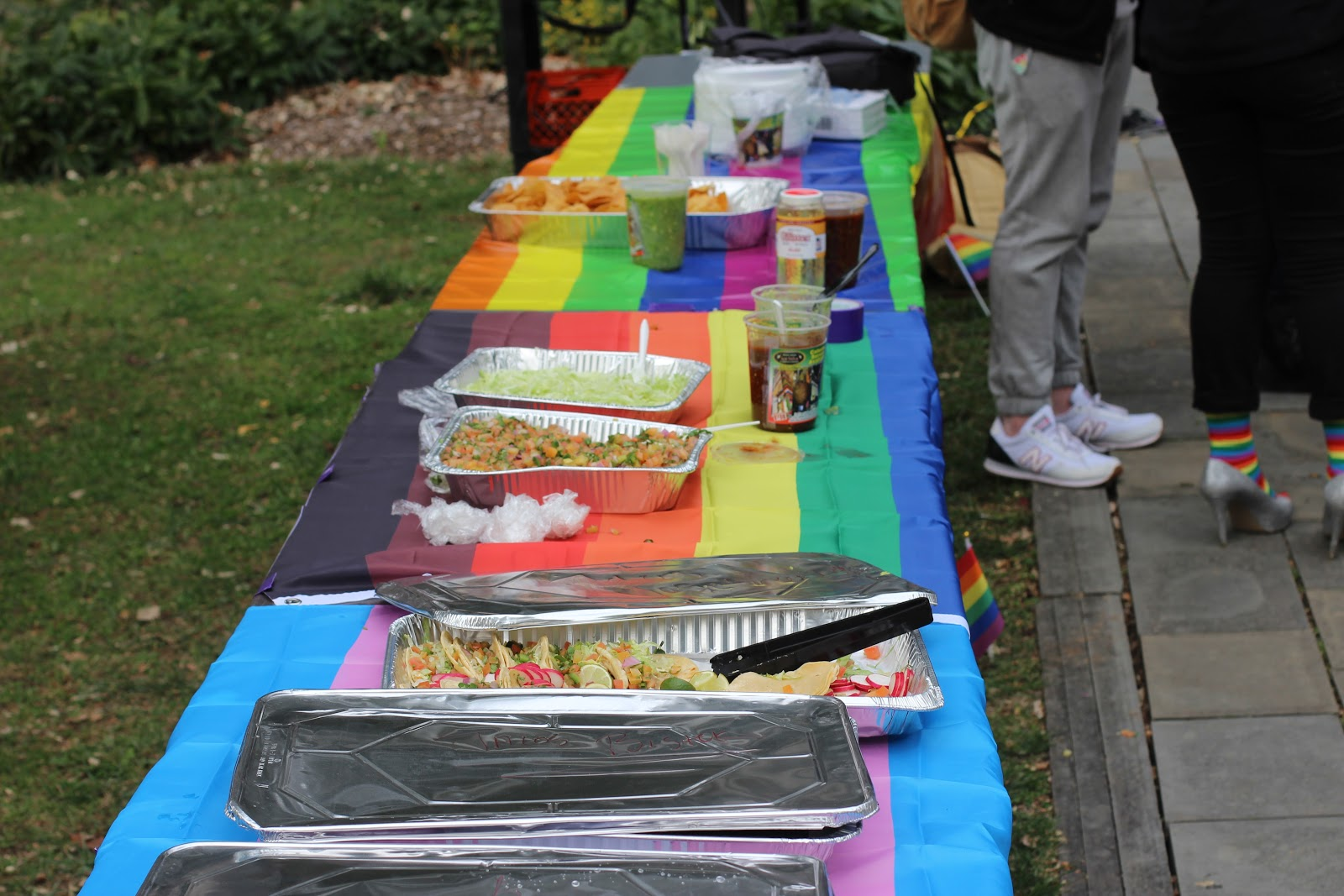 The Pride Month Committee (PMC) serves food during the Fashion Show