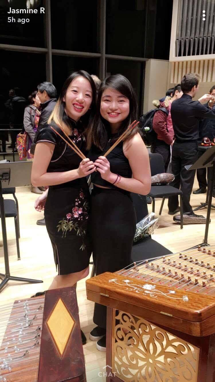 Wang (right) with fellow yangqin instrumentalist Liao after their performance. (Photo courtesy of Liao)