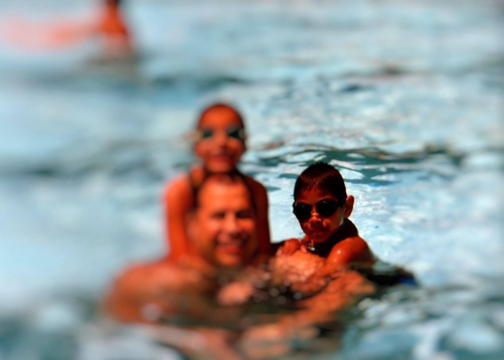 Chris and his family at their predominantly white swim club; circa late 2003.