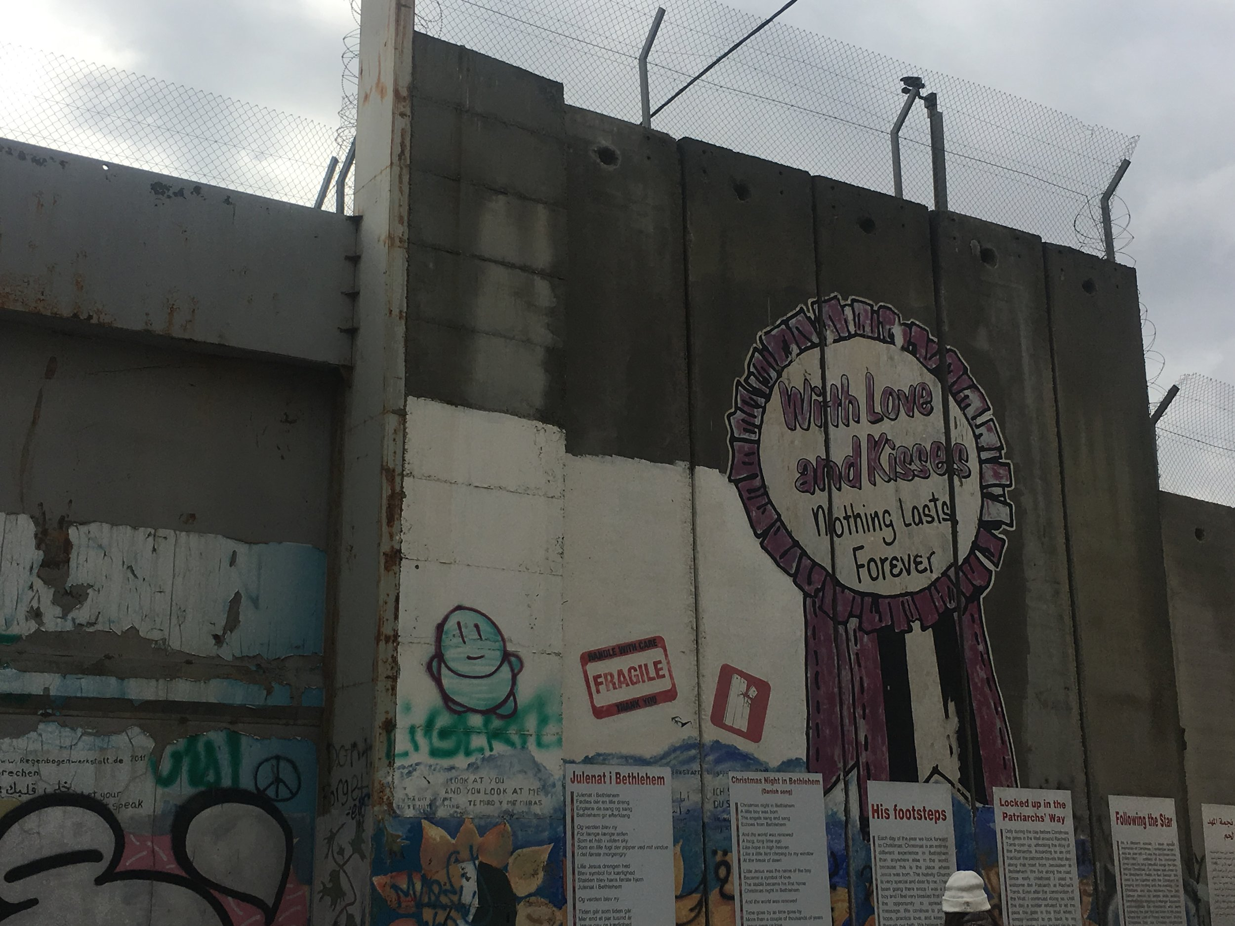 """Separation wall art. Bethlehem, West Bank. """"With love and kisses nothing lasts forever."""""""