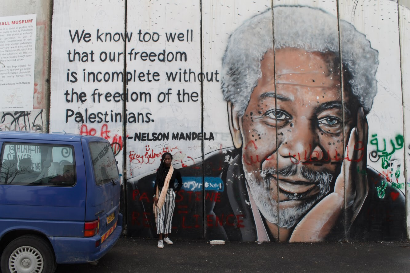 """Separation wall art. Bethlehem, West Bank. """"We know all too well that our freedom is incomplete without the Palestinians."""""""