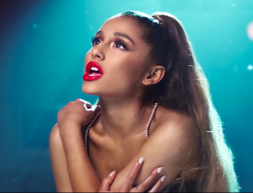 "Grande hugging herself and looking up in the ""breathin"" music video"