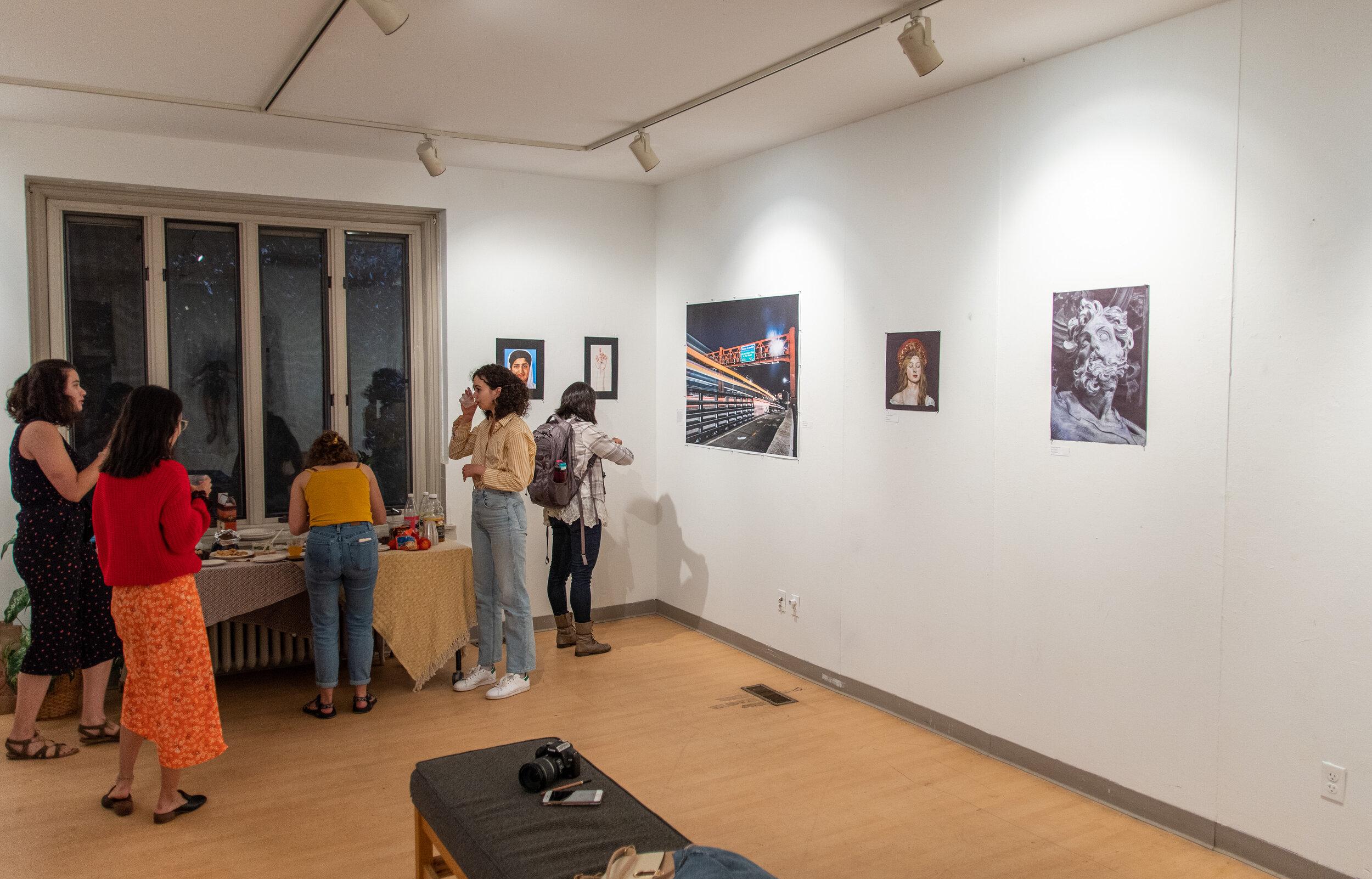 Attendees enjoy the artwork in Kitao Gallery.