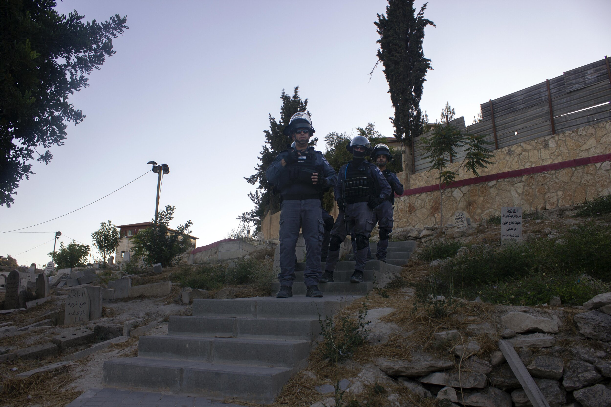 Police standing in Issawiya's cemetery
