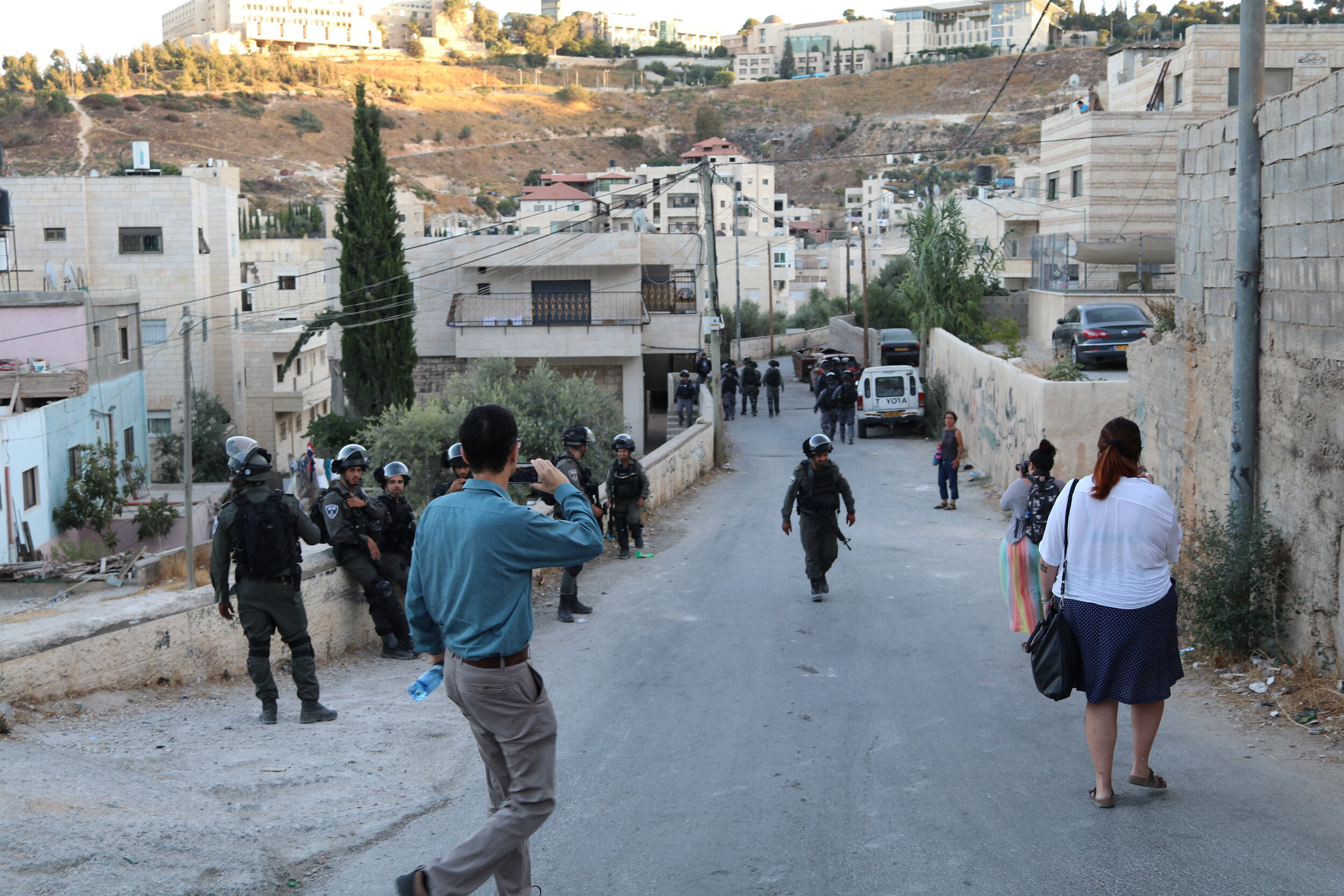 israeli and American activists following and documenting the police. Photo by Bridget Powers.